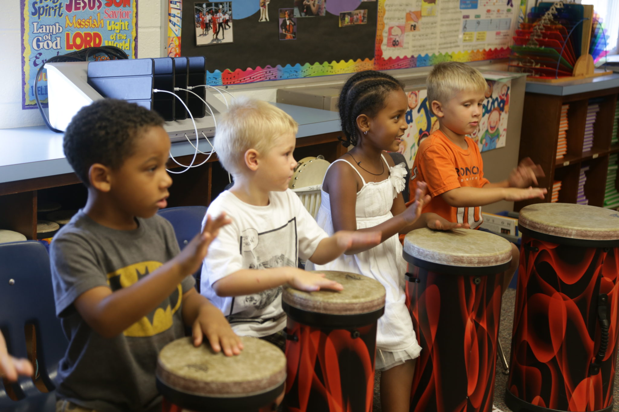 students playing drums in classroom