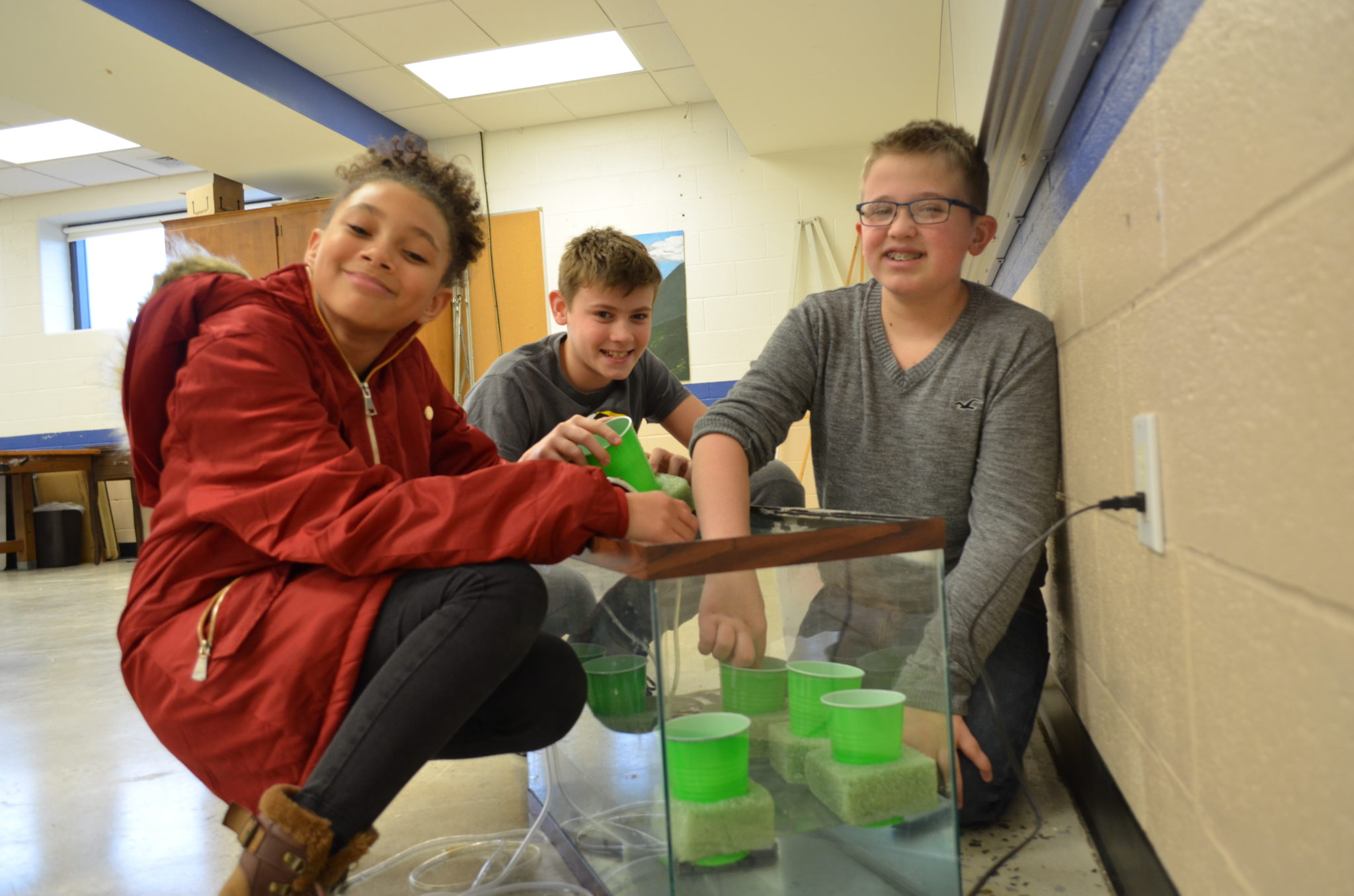 students with a fish tank