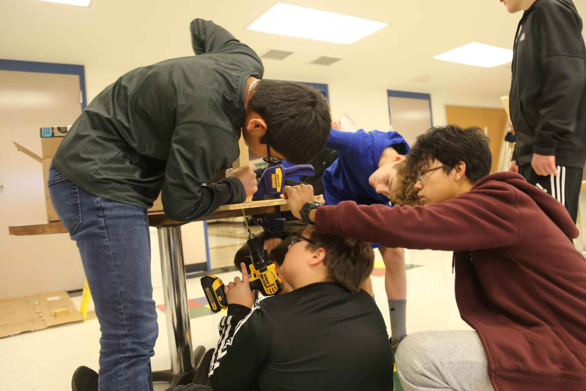 students building with power tools