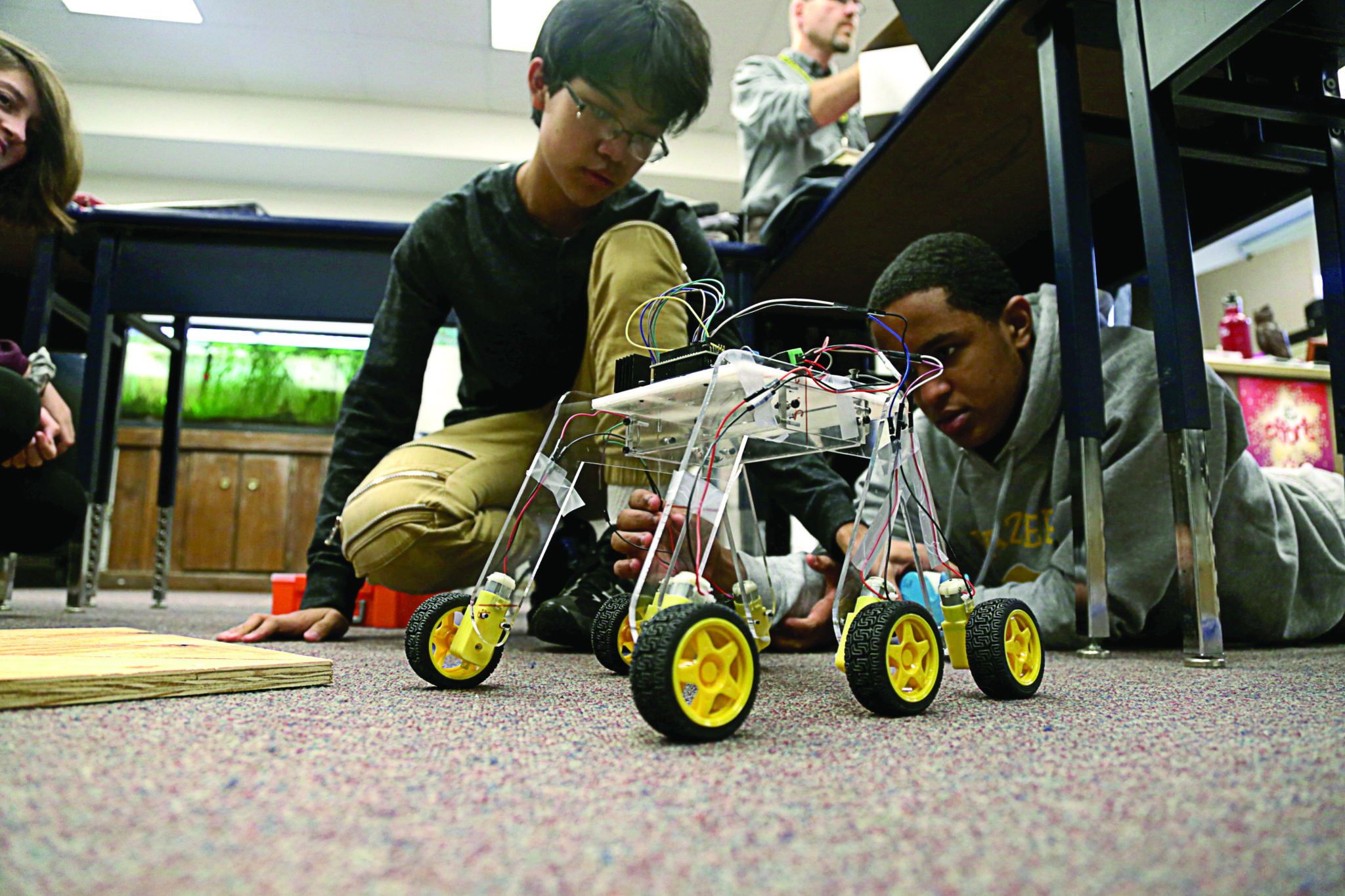 students maneuvering their robots