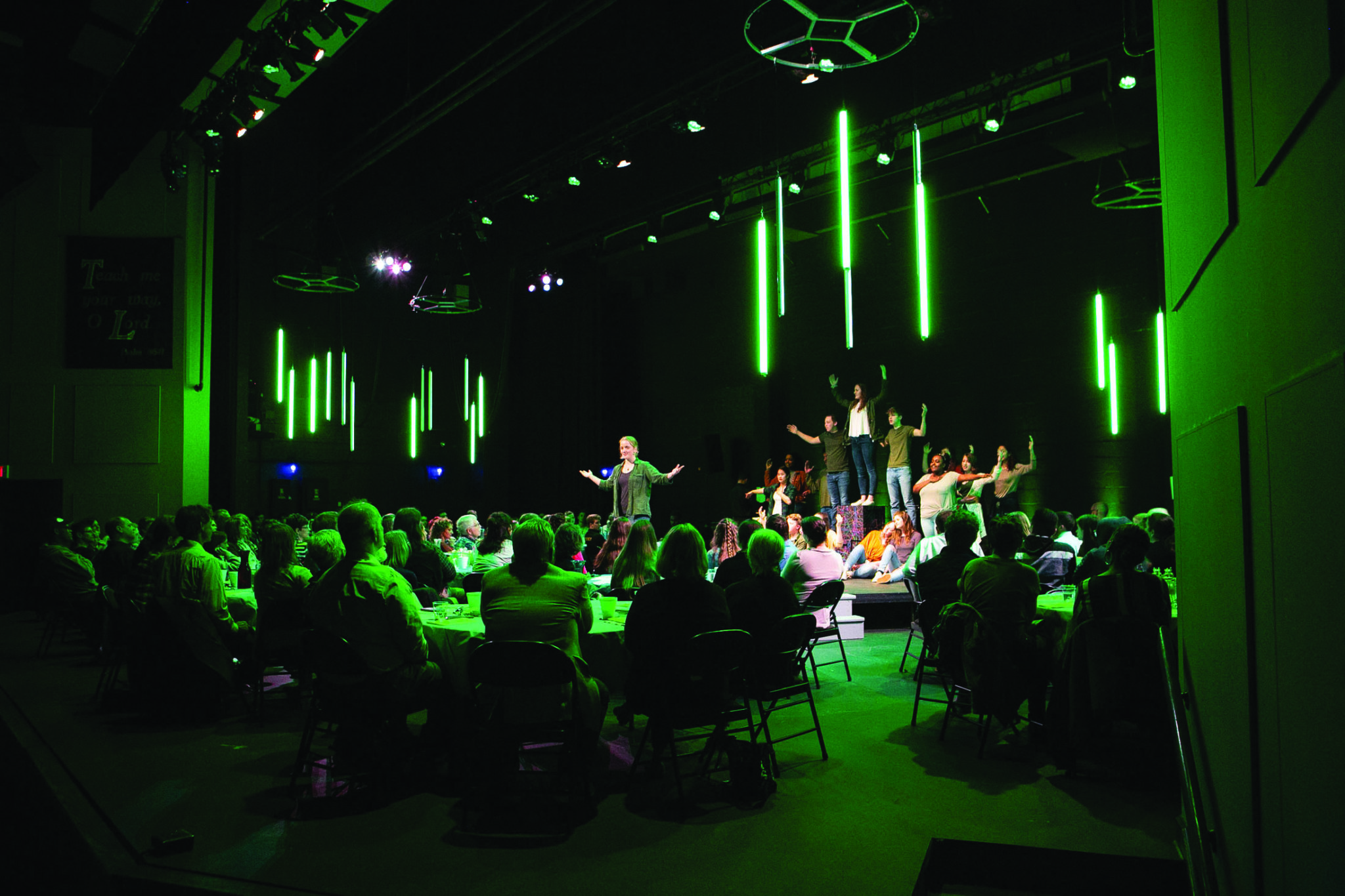 people gathered in a room for a performance