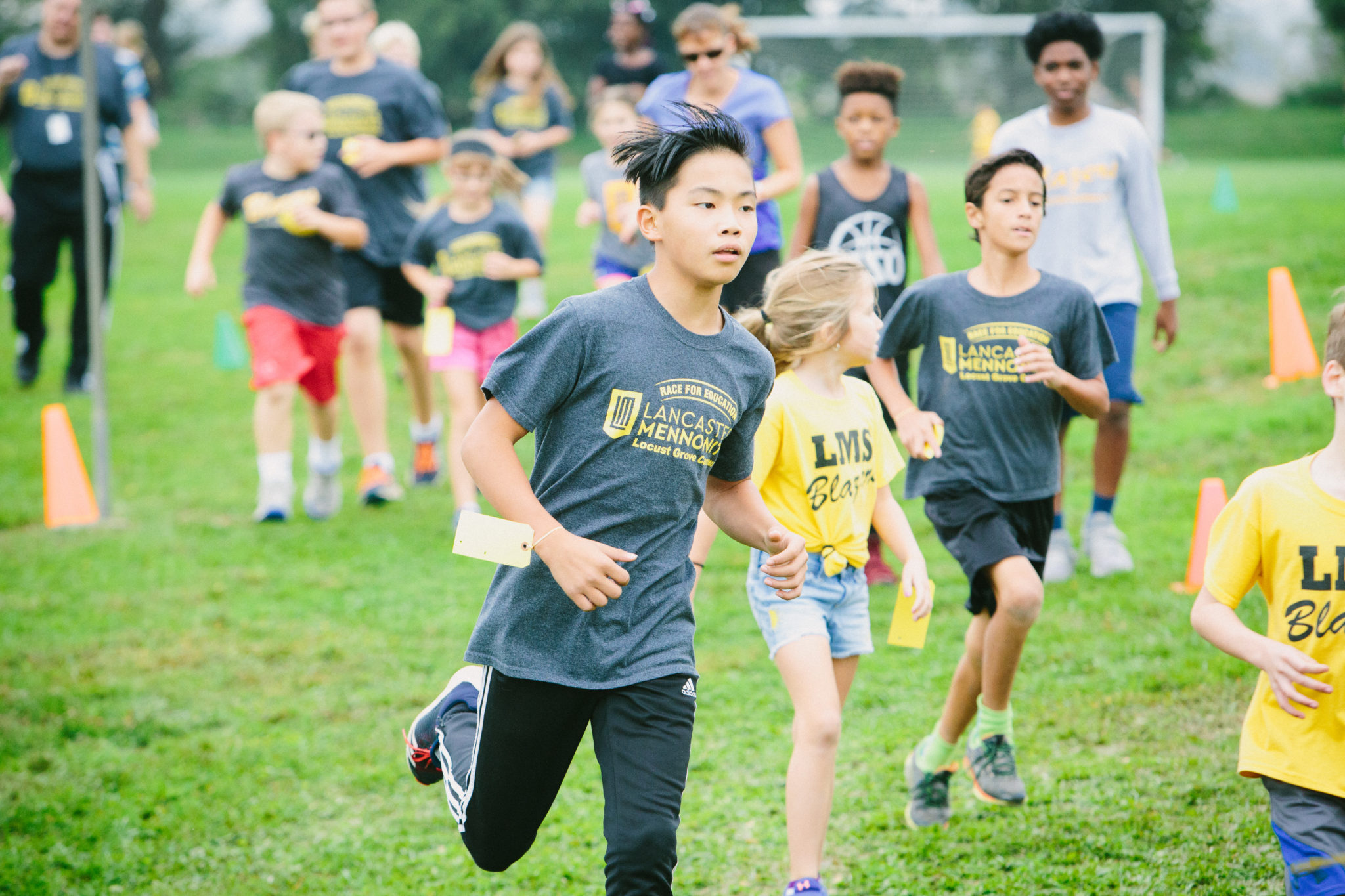 race for education, students running on athletic fields