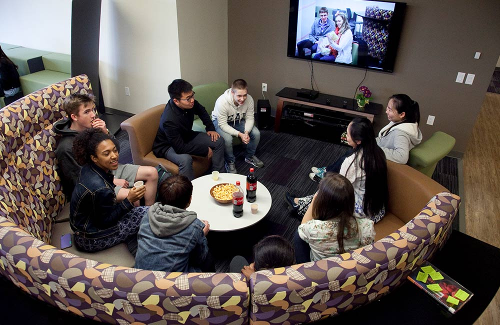 students conversing in dorm great hall