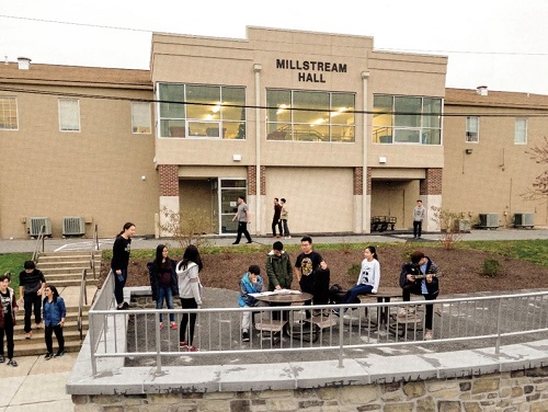 Millstream Hall entrance with students outside