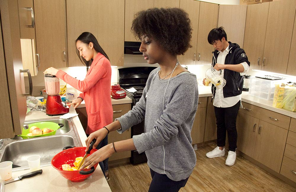 students cooking in dorm kitchen