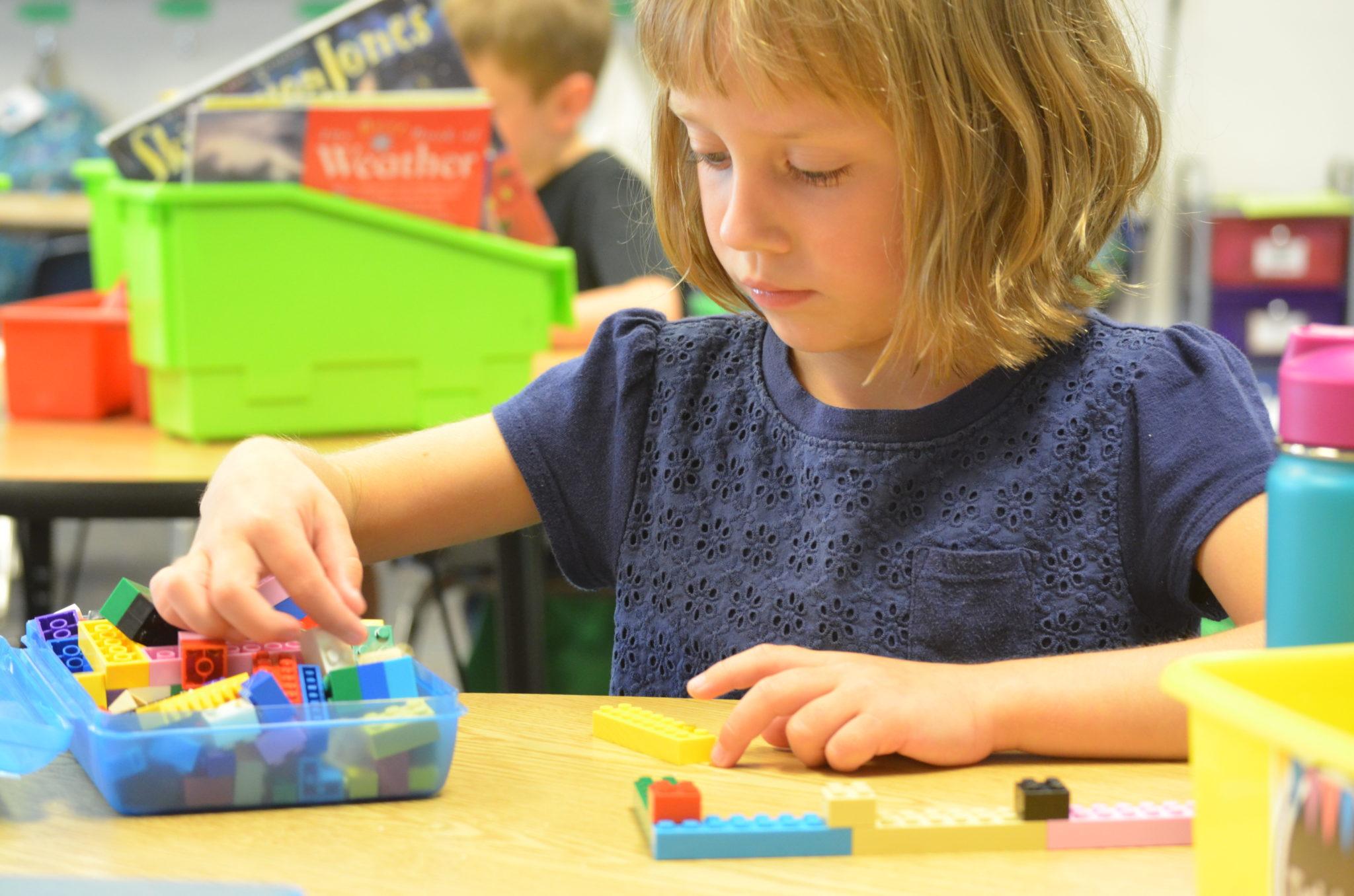 Student playing Legos