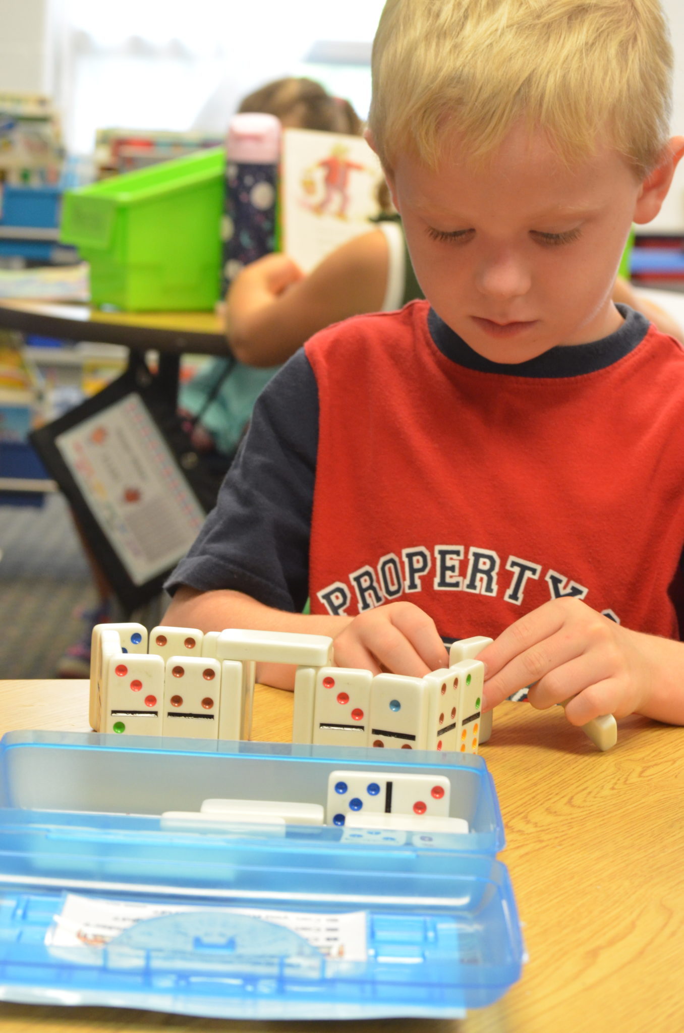 Child learning with dominoes