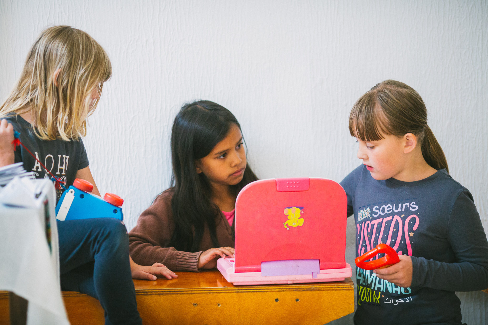 students gathered around a laptop