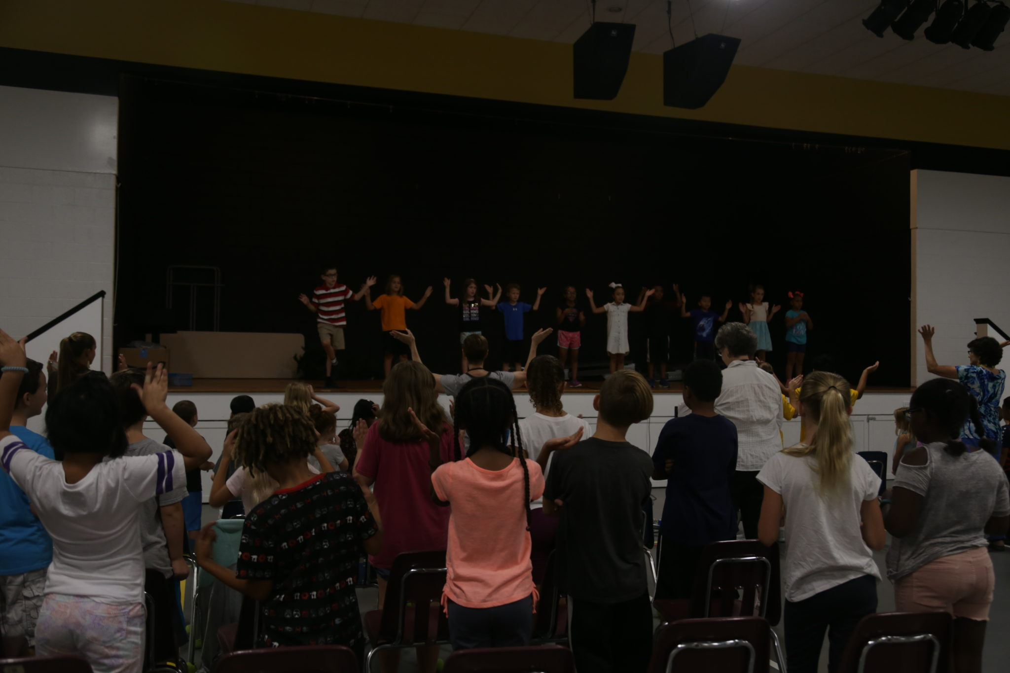 Students singing and dancing