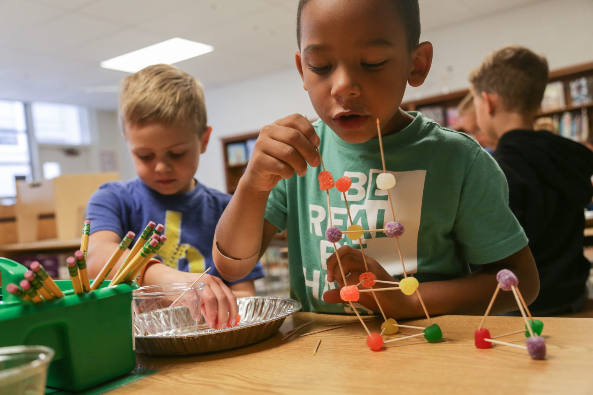 students building with candy & toothpicks