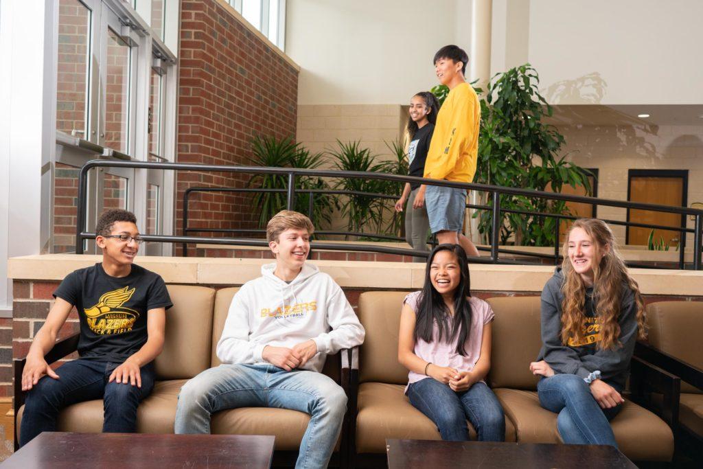 atrium with students smiling