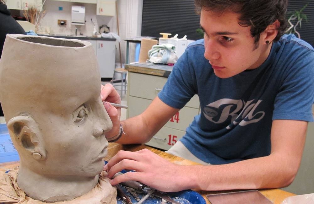 student sculpting