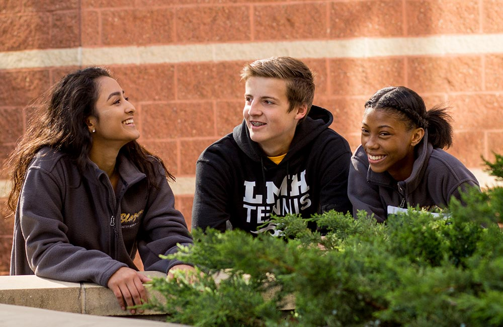students on campus smiling