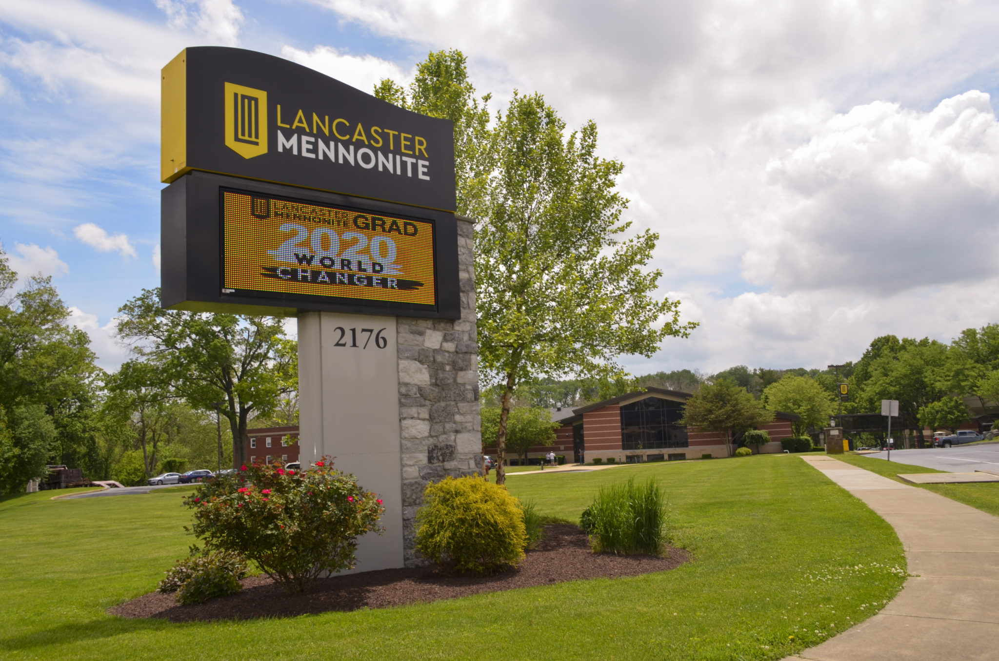 Road sign and campus view