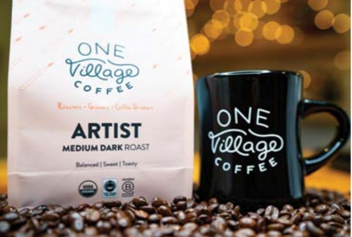 one village coffee and cup