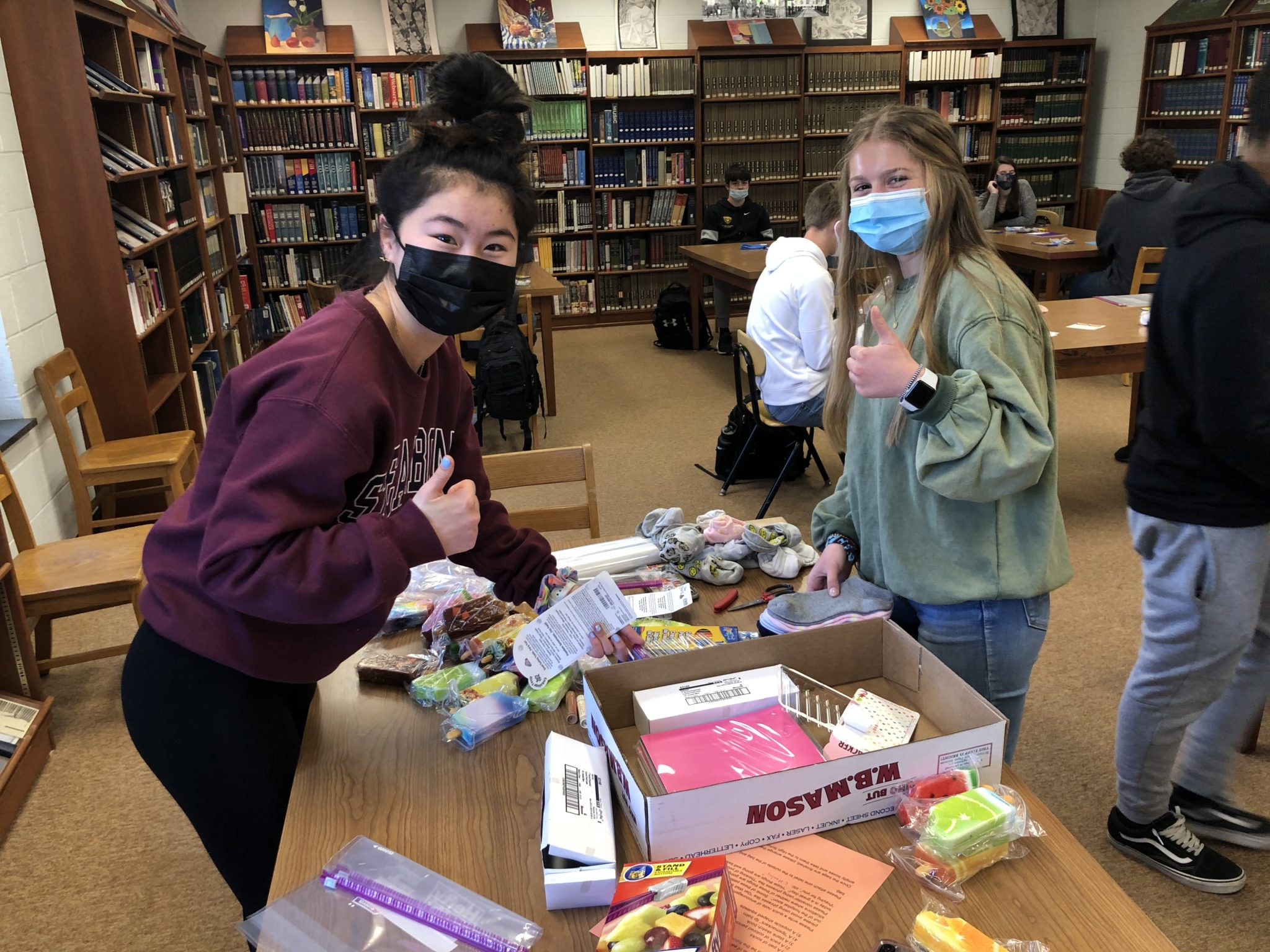 students packing care packages