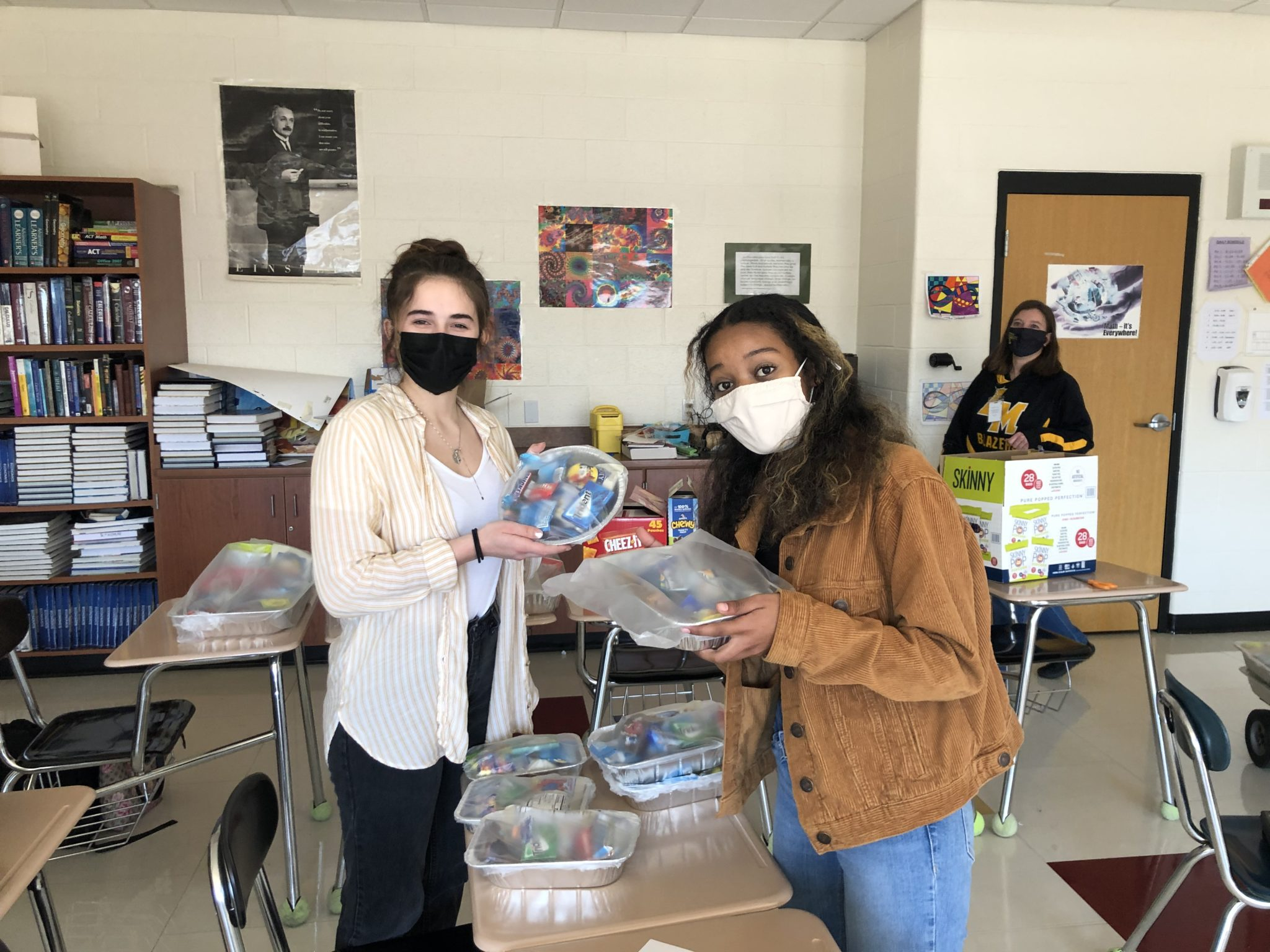 students holding care packages