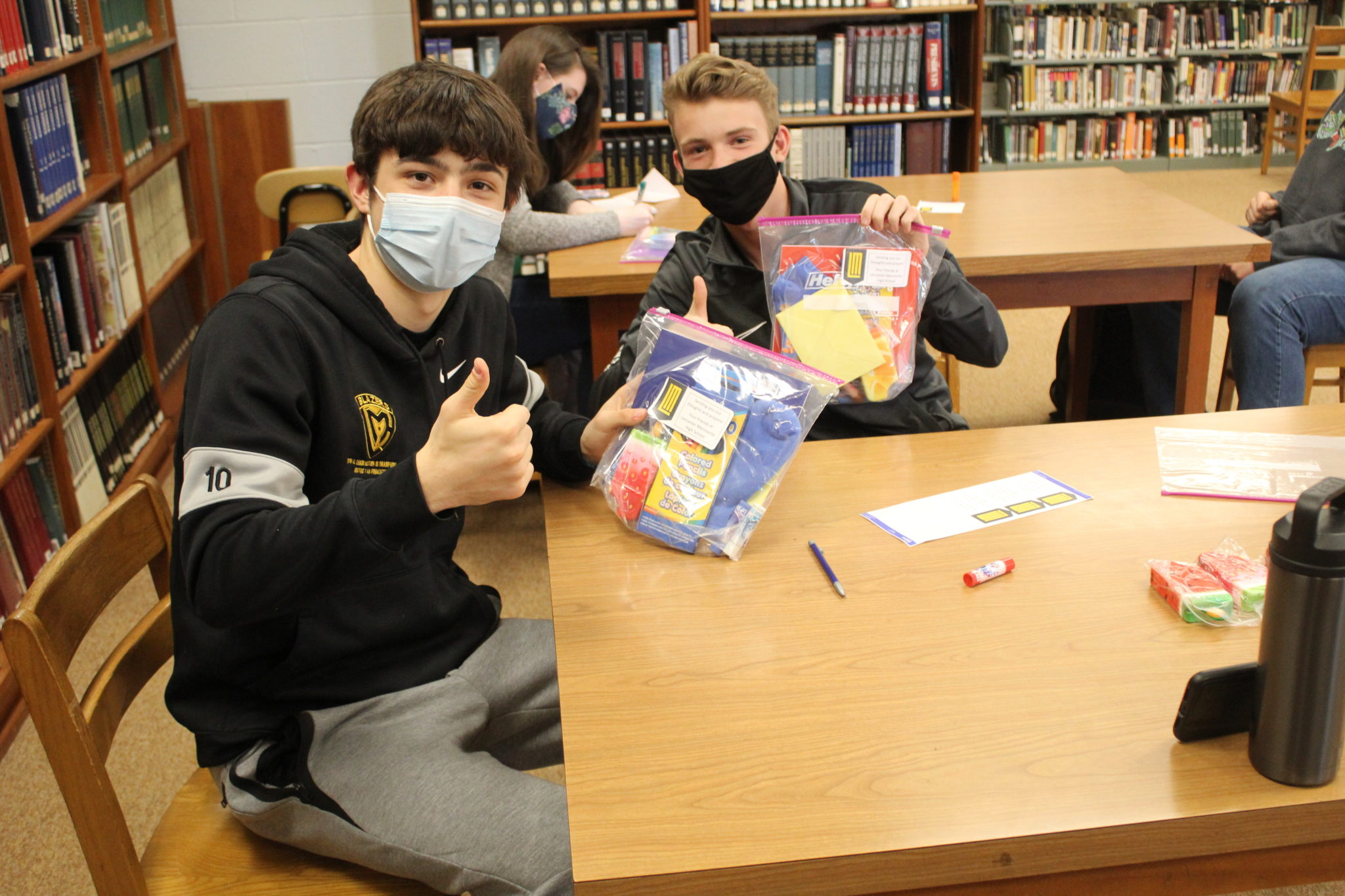 students holding onto care packages