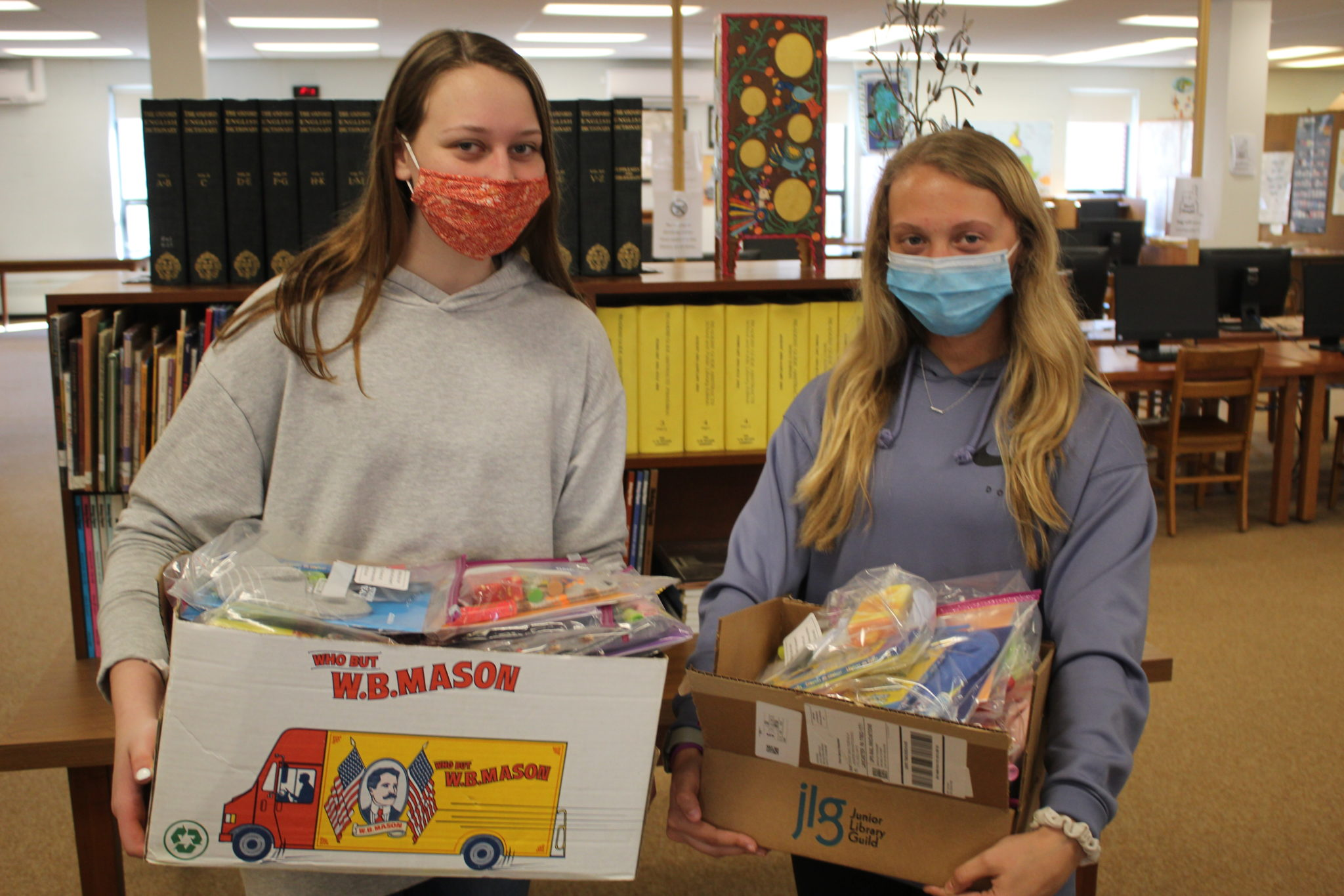 students holding boxes full of care packages