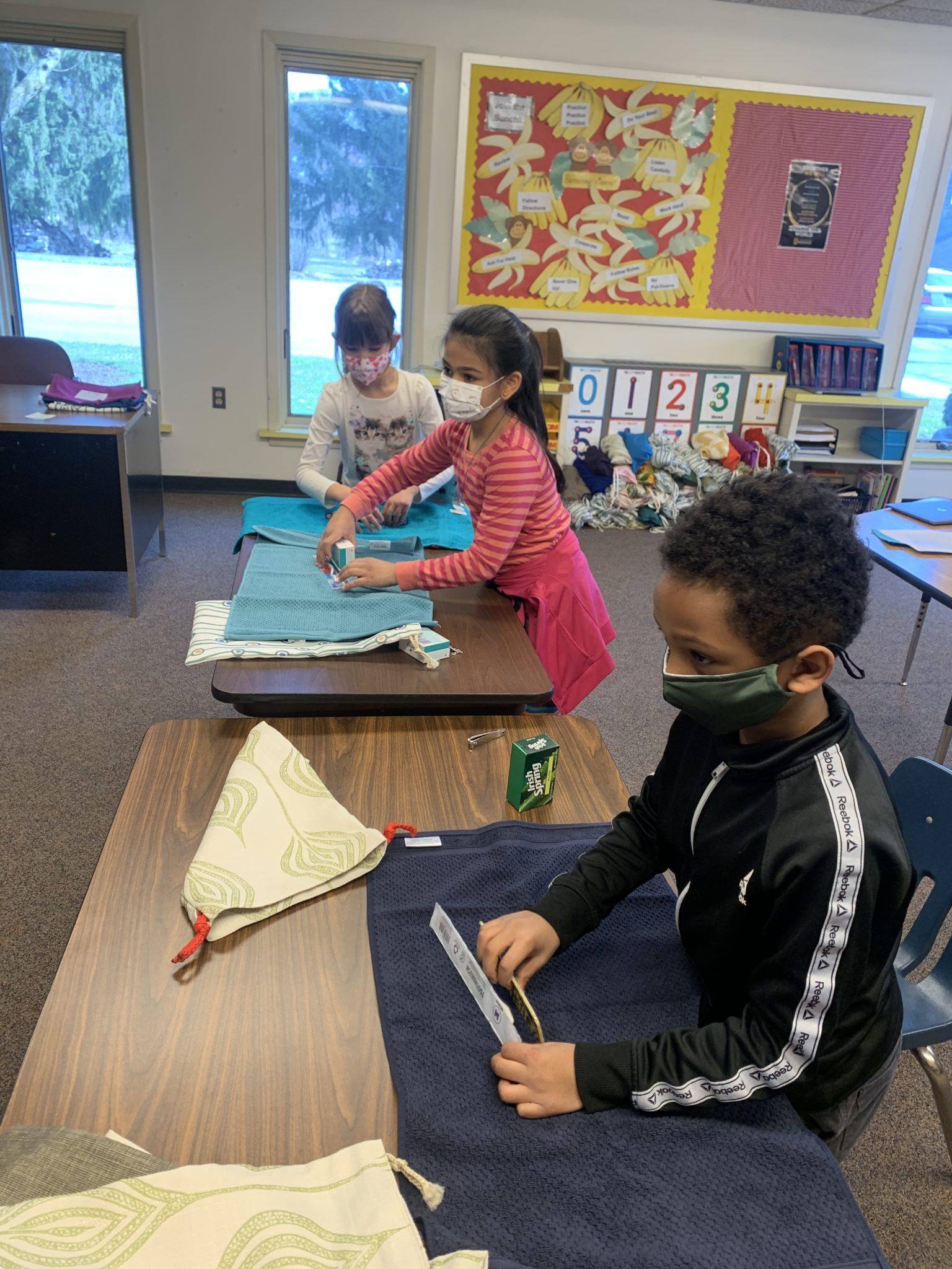 students folding towels