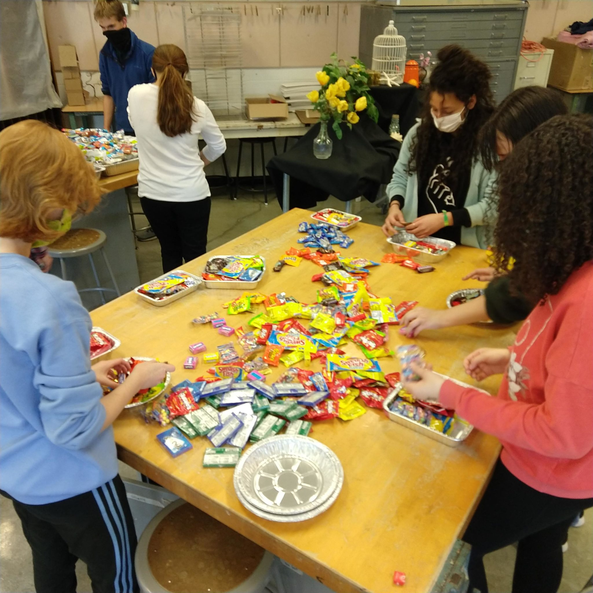 students sorting candy