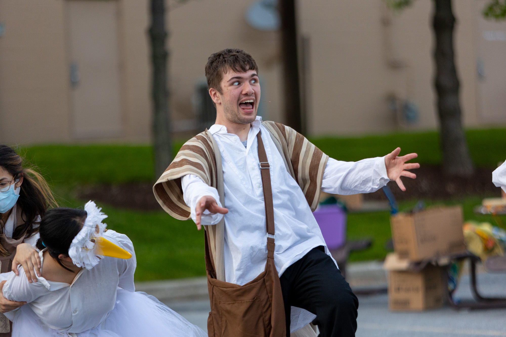 student acting during the performance of all the worlds a stage