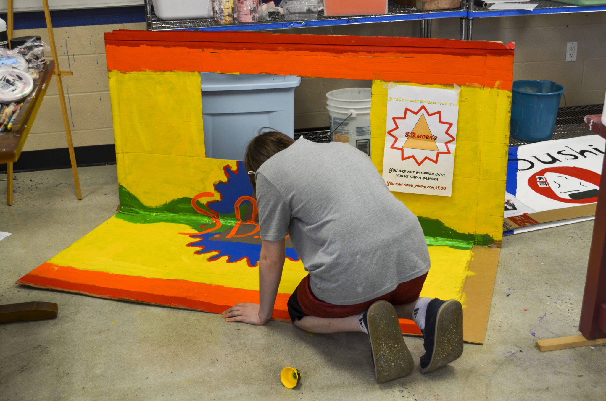 student painting booth