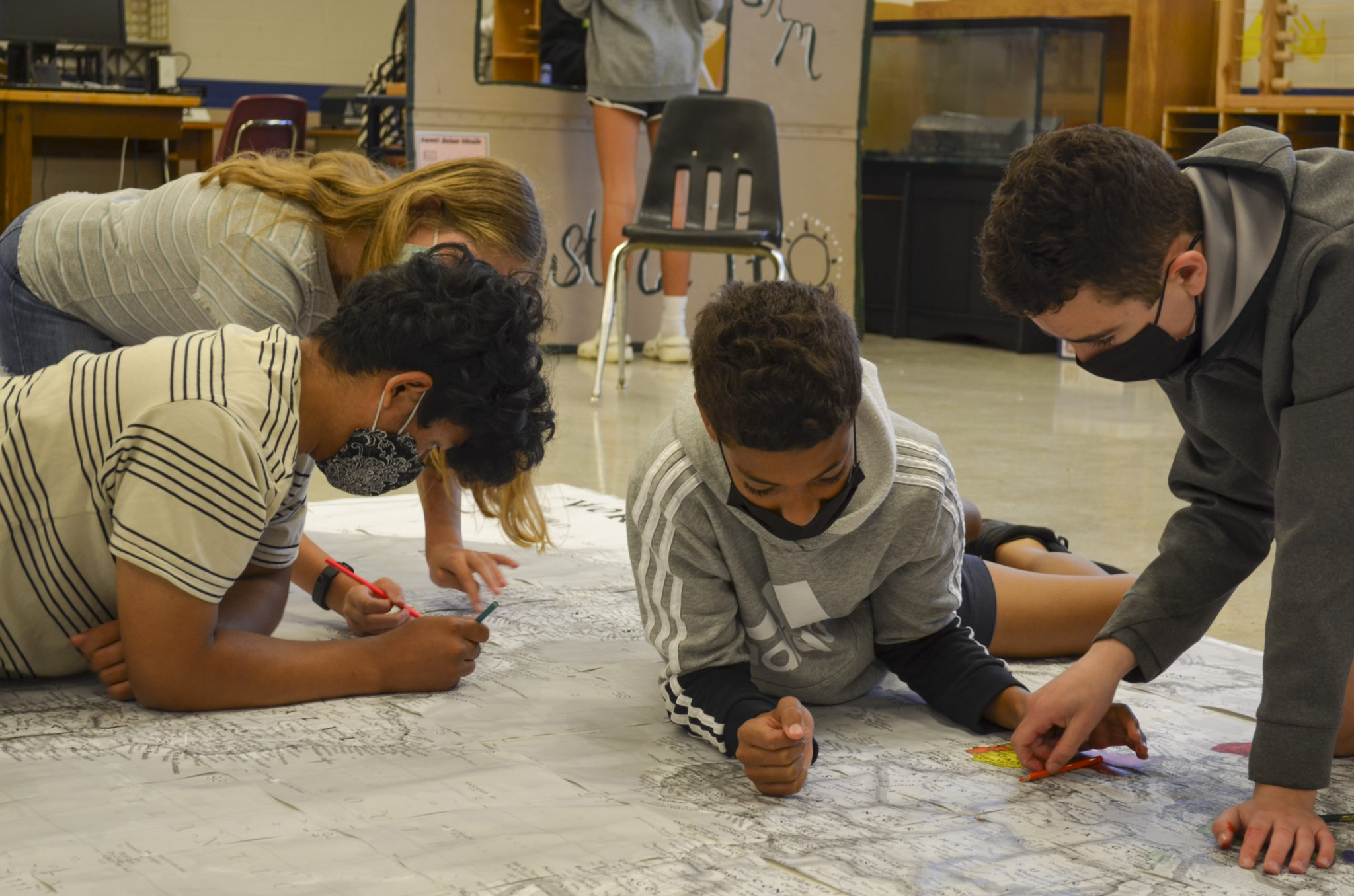 students coloring on map