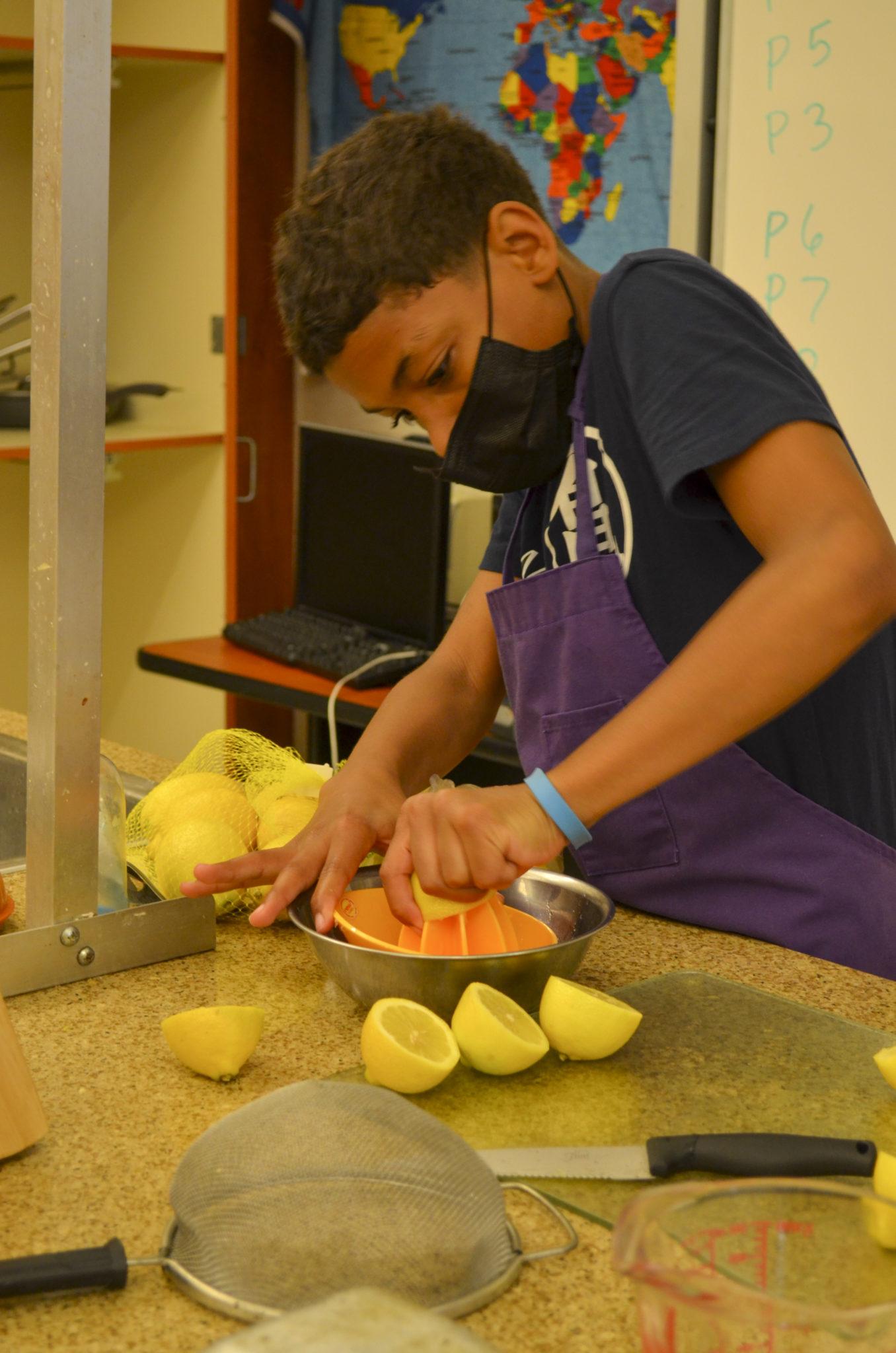 student mashing lemons