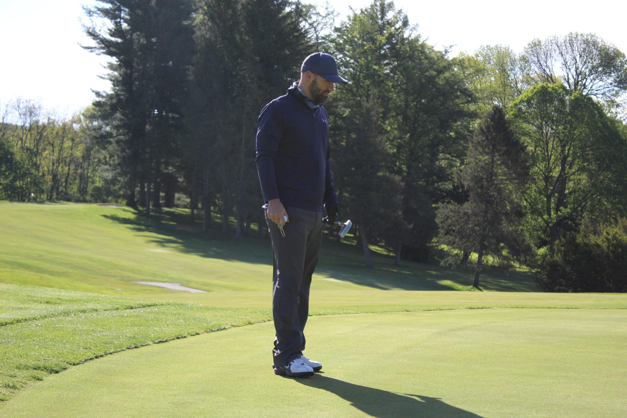 male golfer on green
