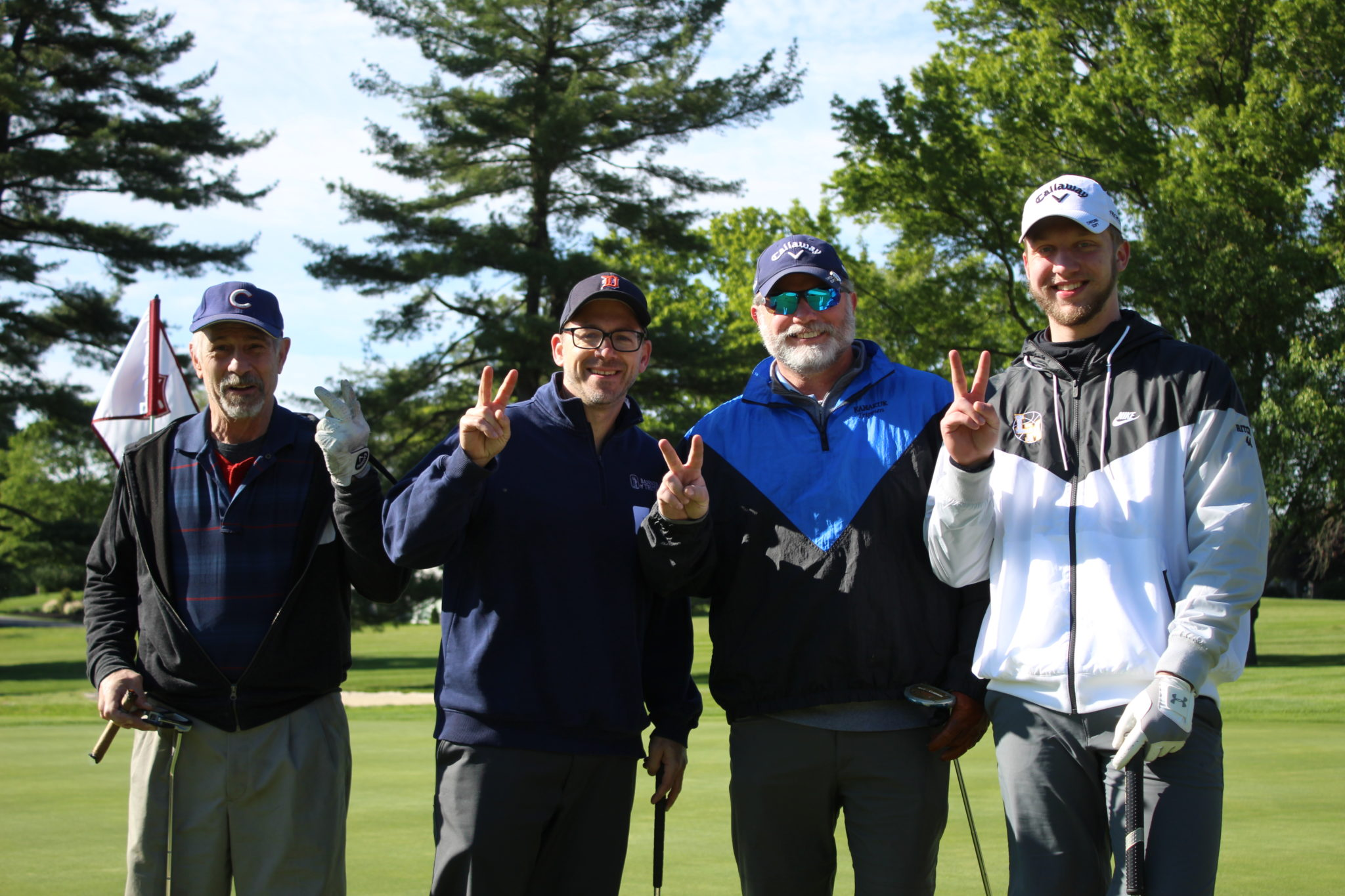 4 male golfers