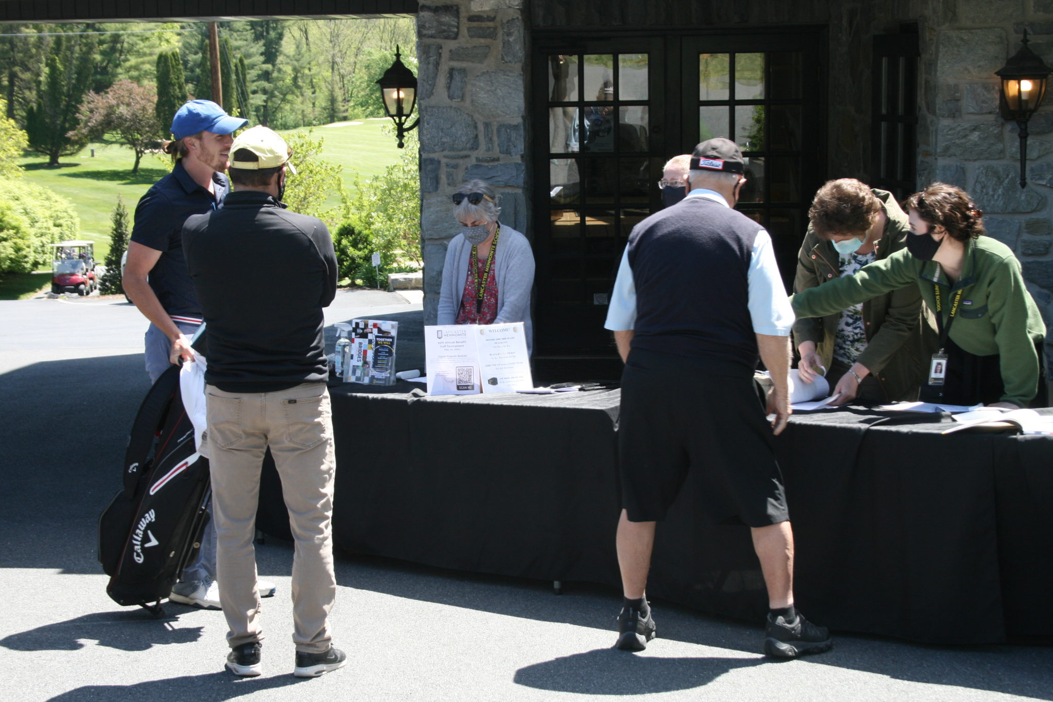 golfers at registration table