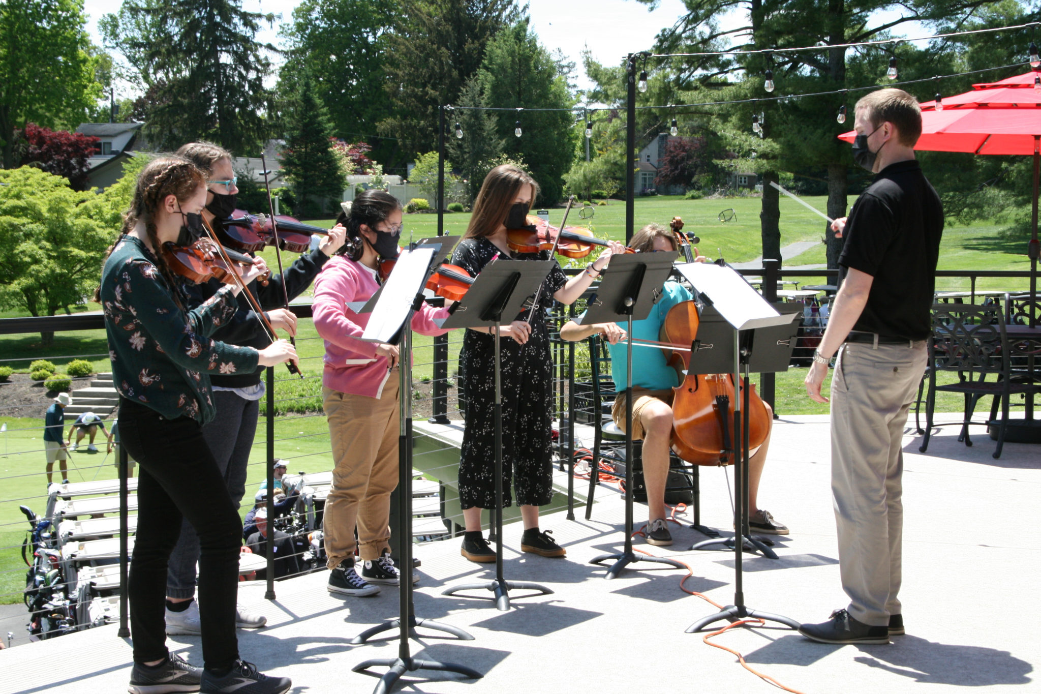 orchestra students playing at golf tournament