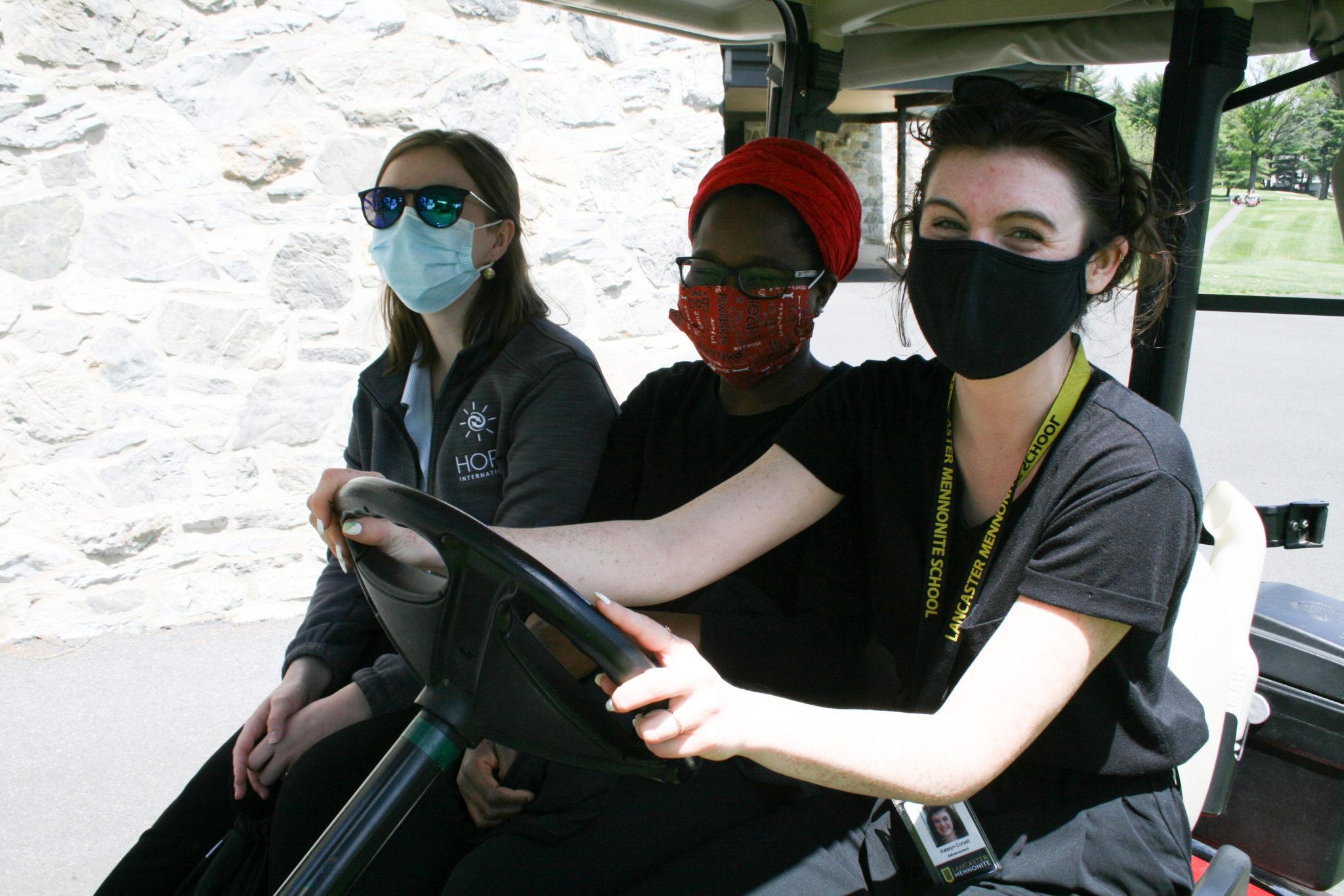 3 women on golf cart