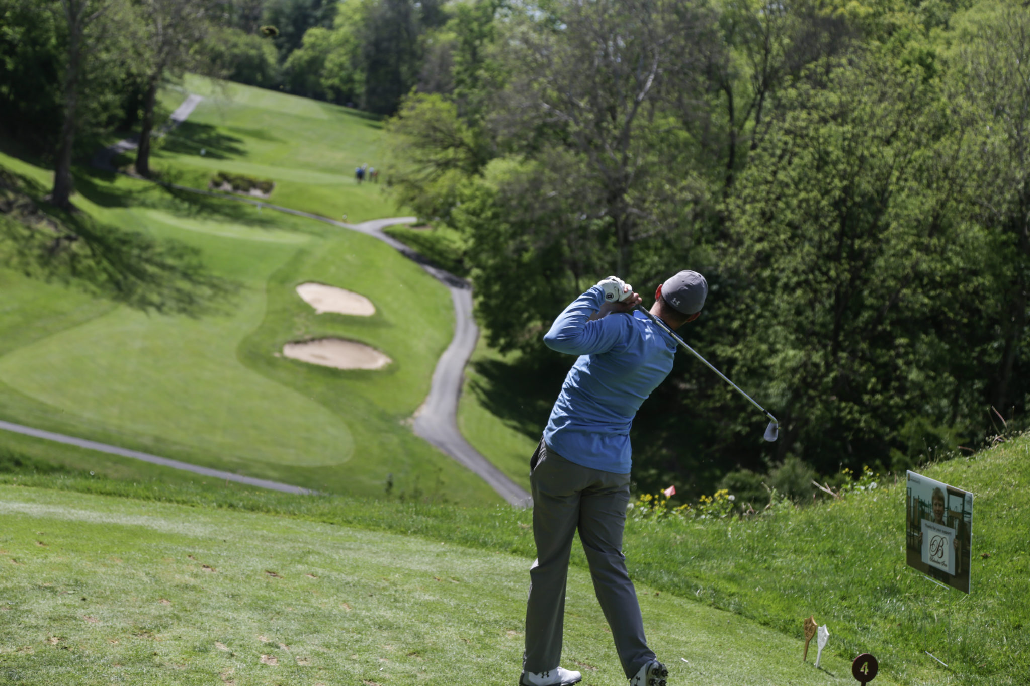 male golfing