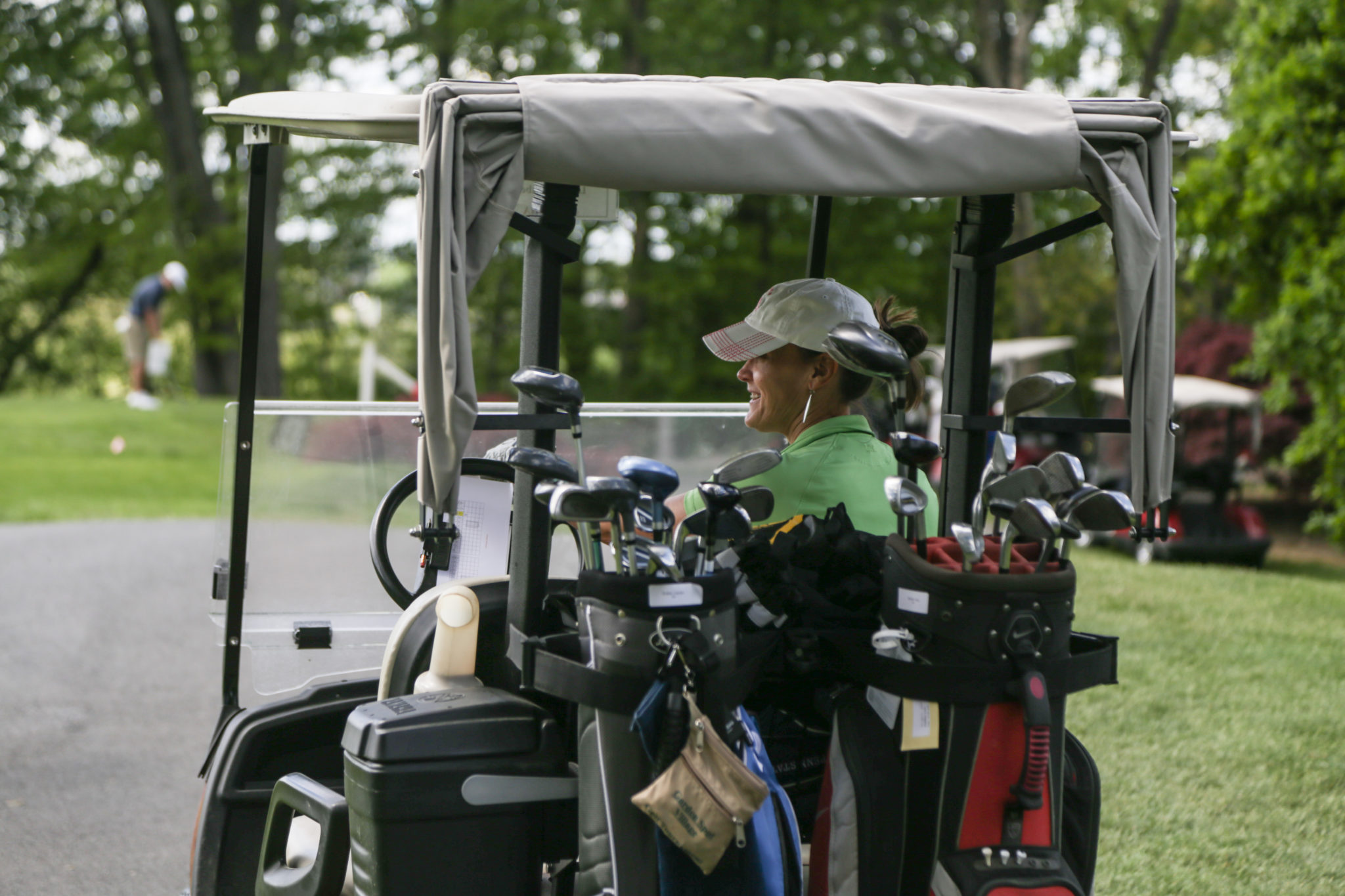 woman on golf cart