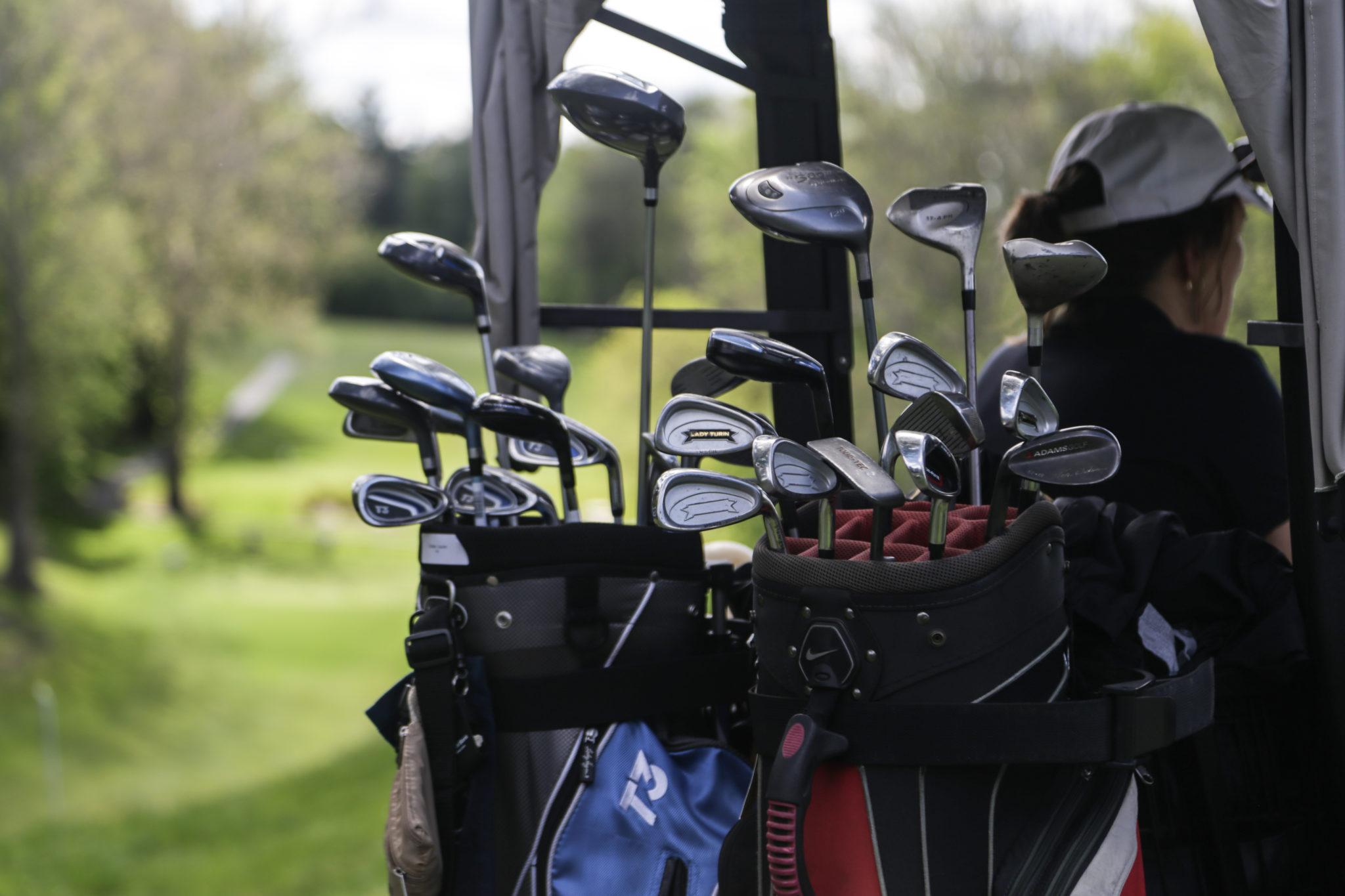 golf clubs on golf cart photo