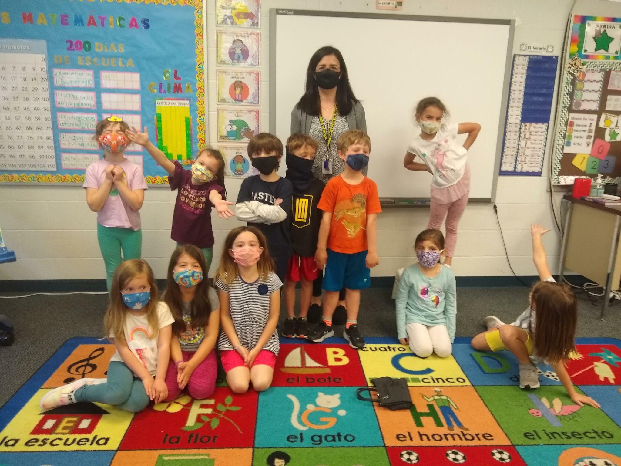 kids and teacher in kindergarten class
