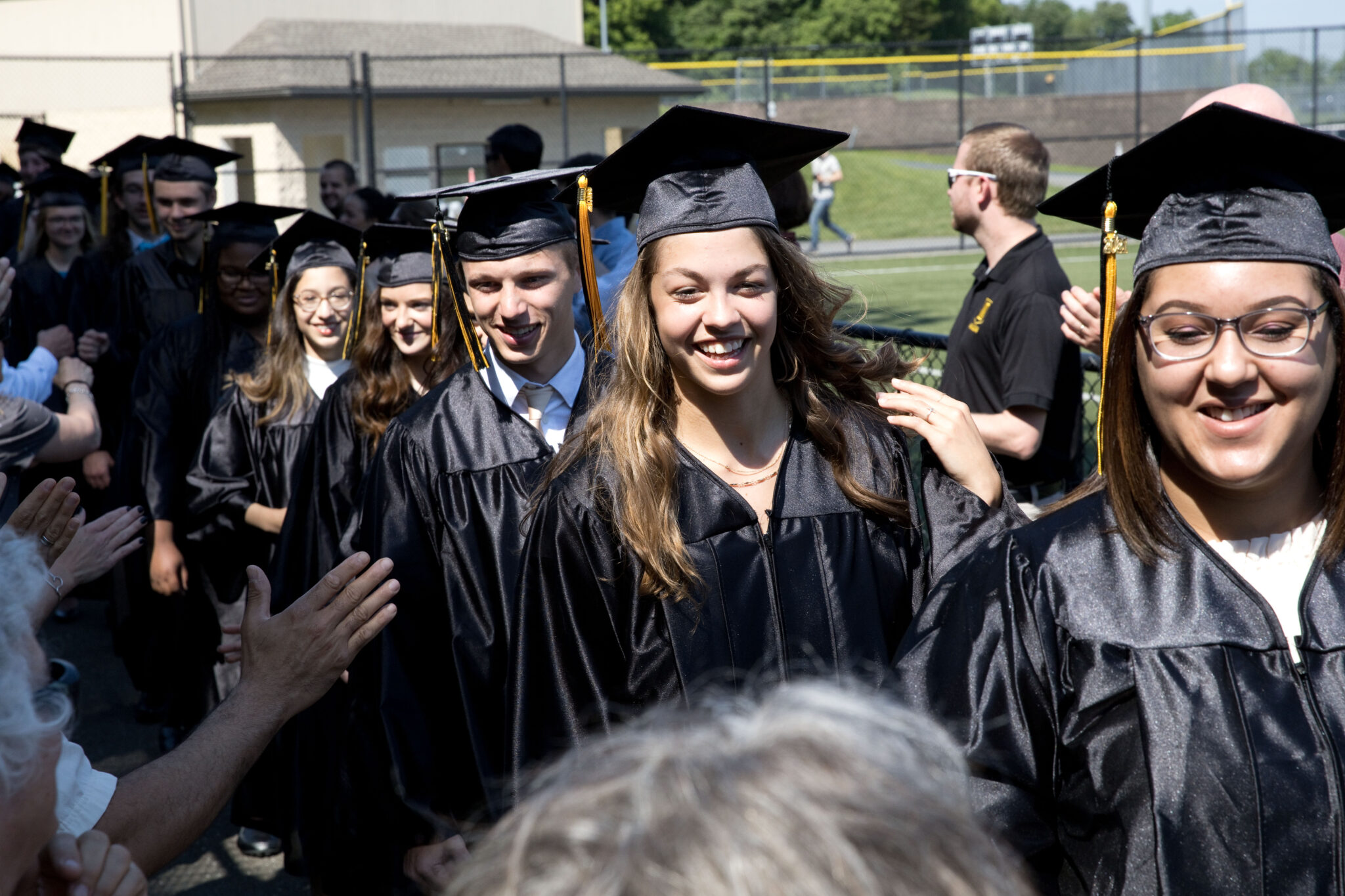 students walking in to graduation