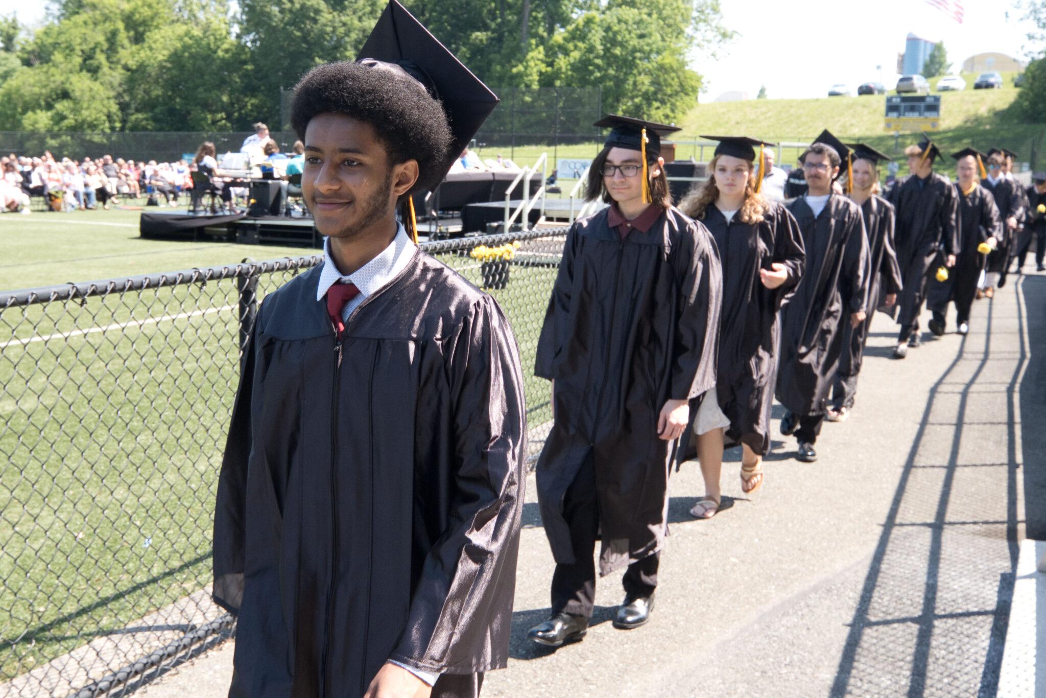 graduates walking into commencement