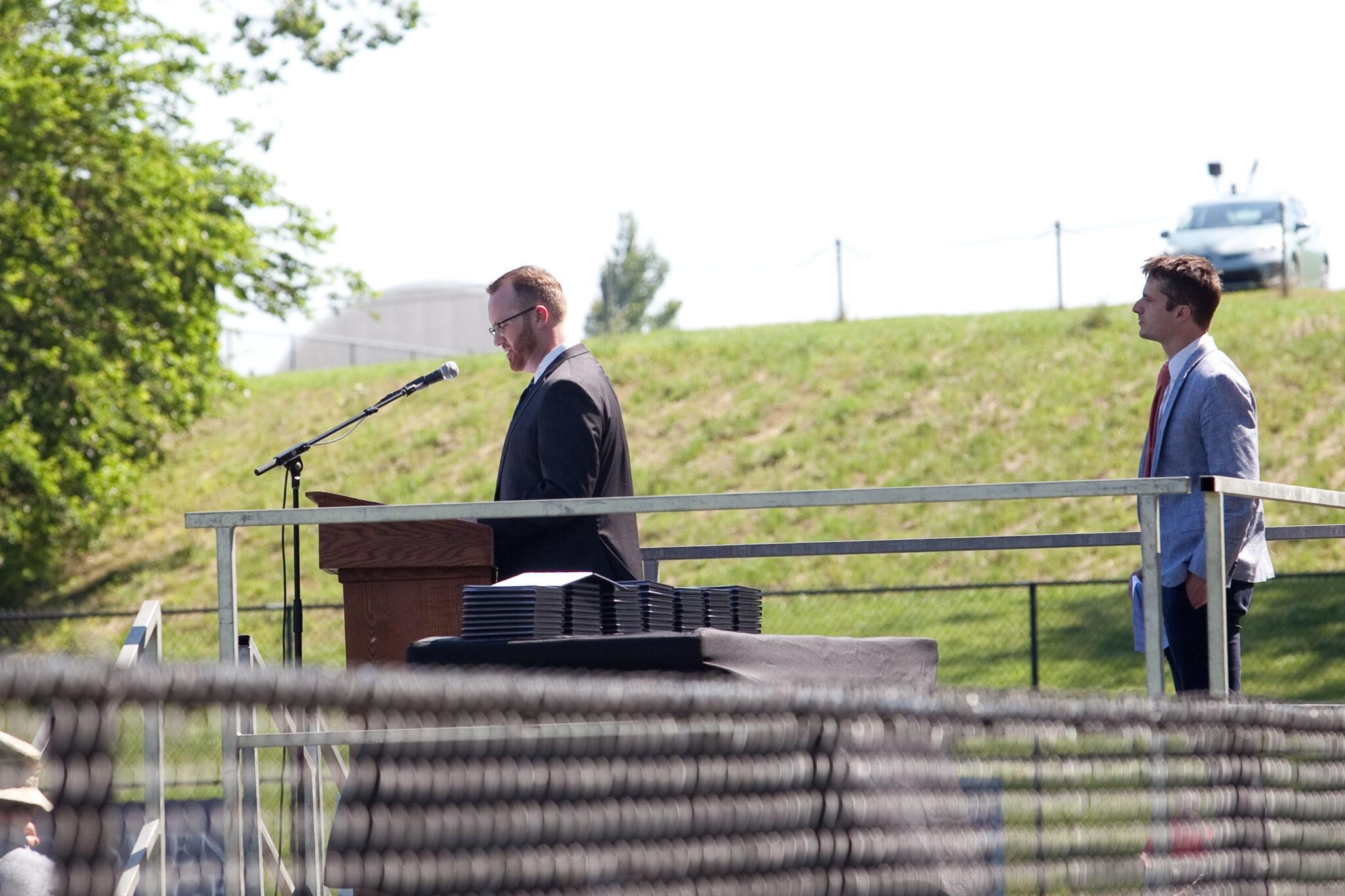 assistant superintendent speaks at podium