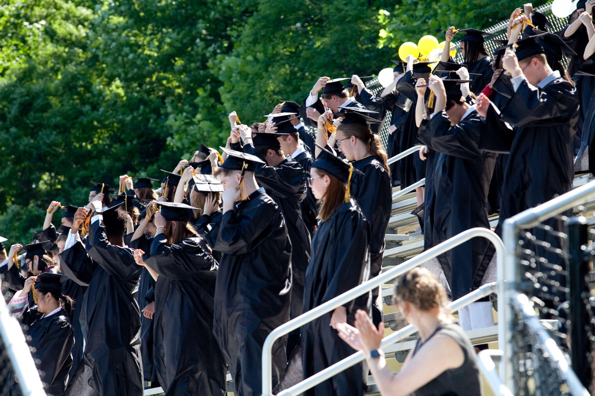 graduates at commencement service