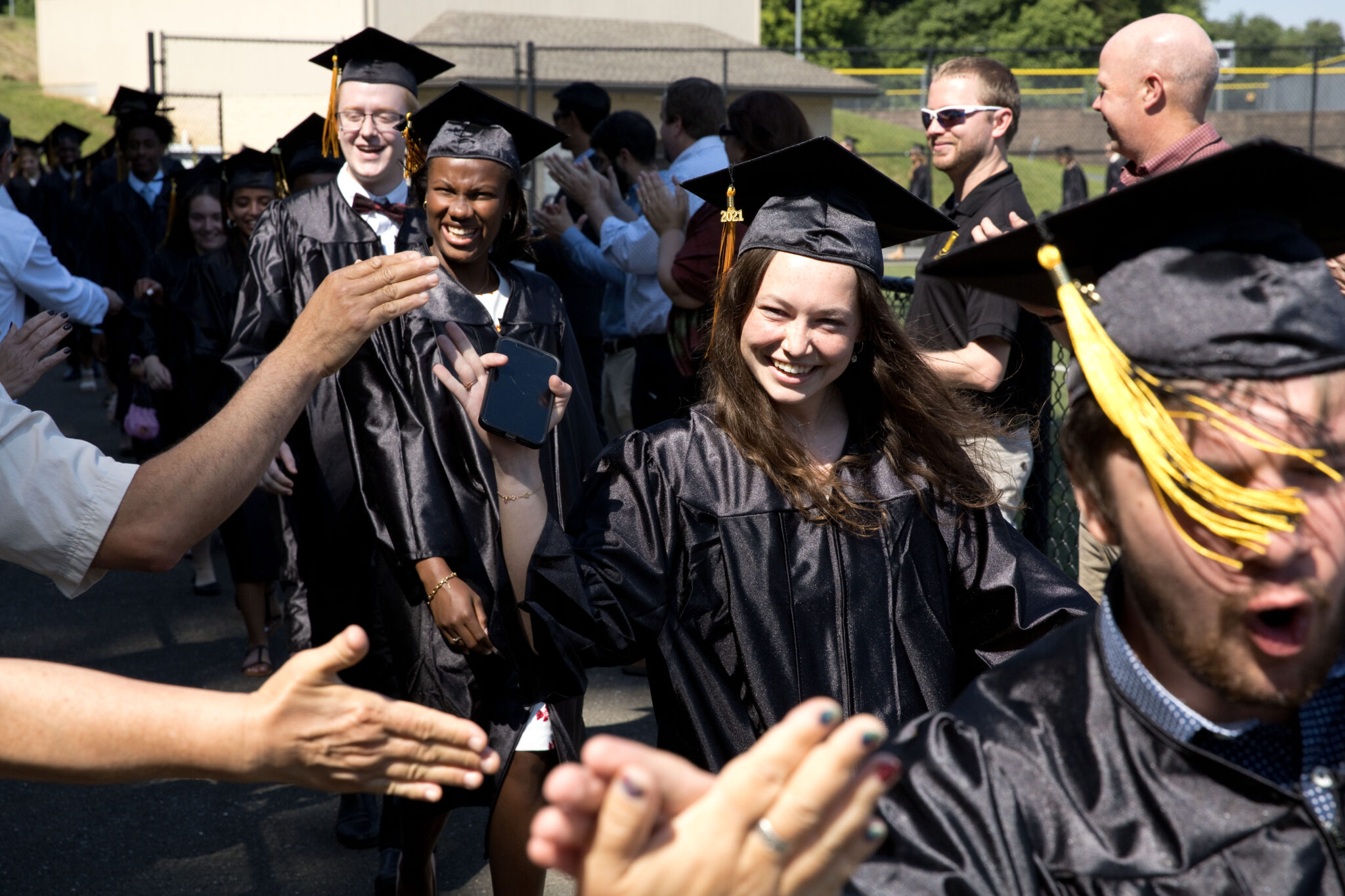 family and friends celebrate graduation