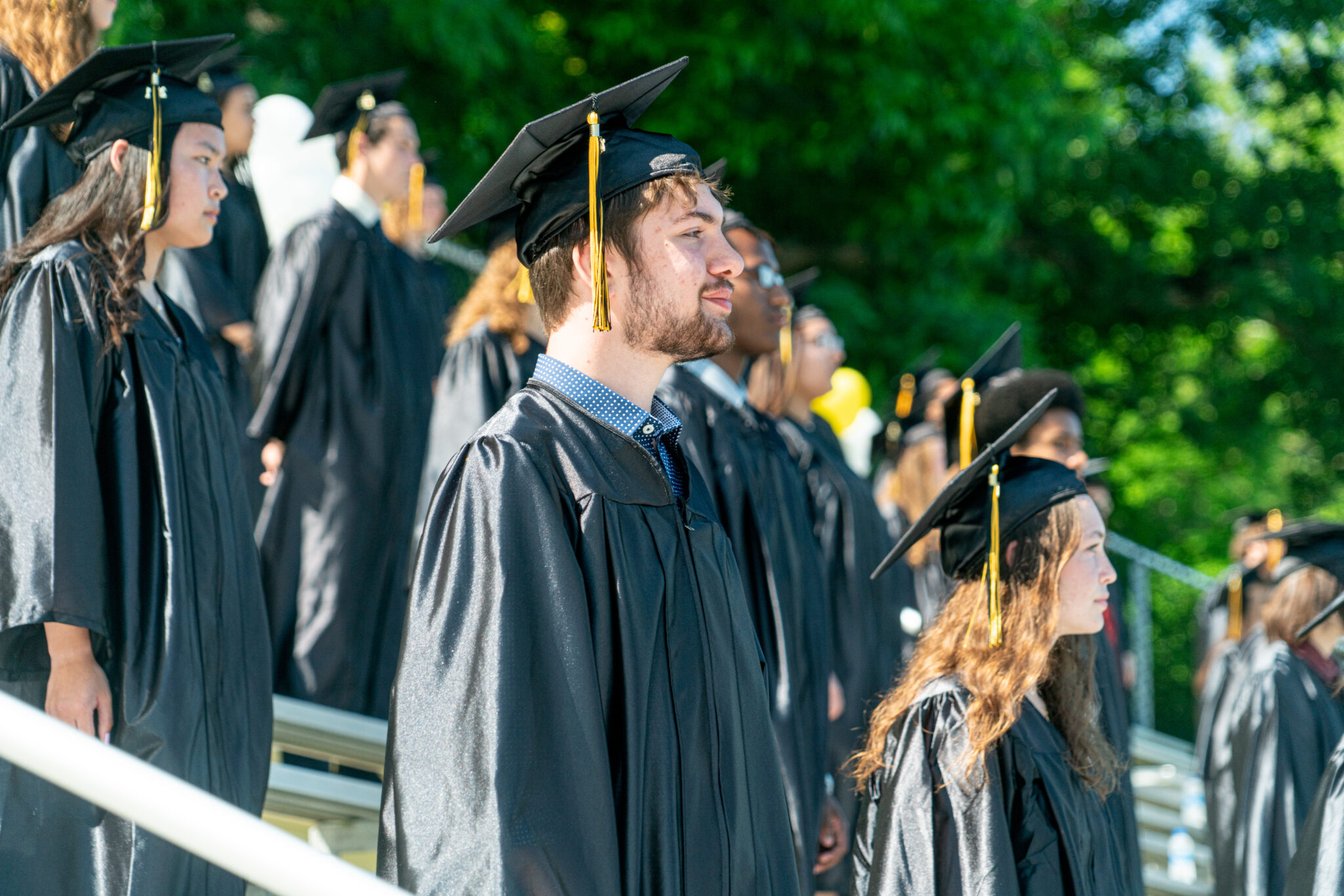 graduates sitting in bleachers at commencement