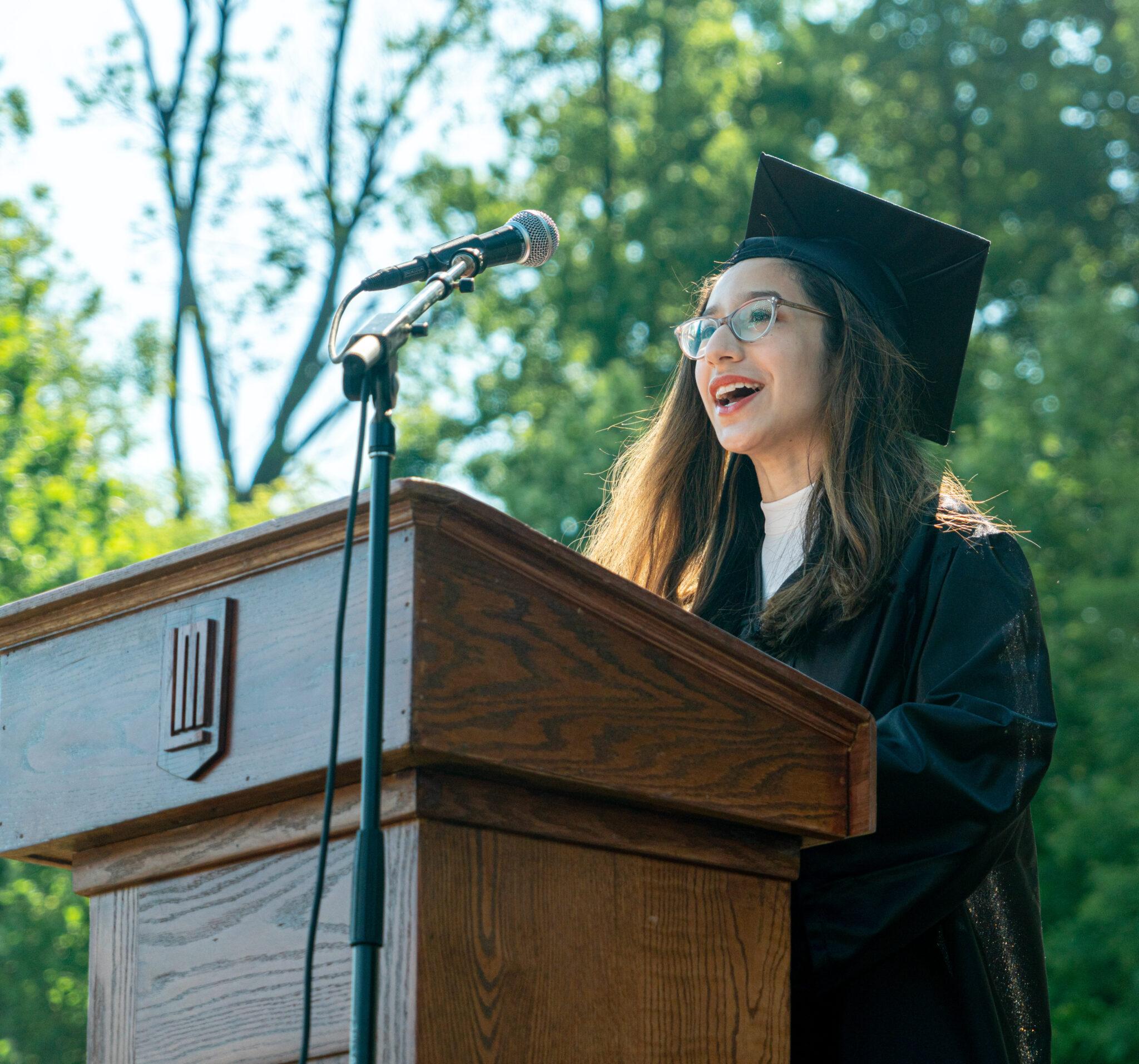 student talking at podium