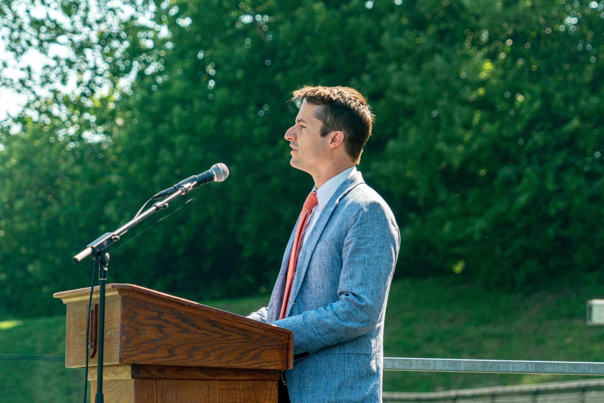 Principal talking at podium