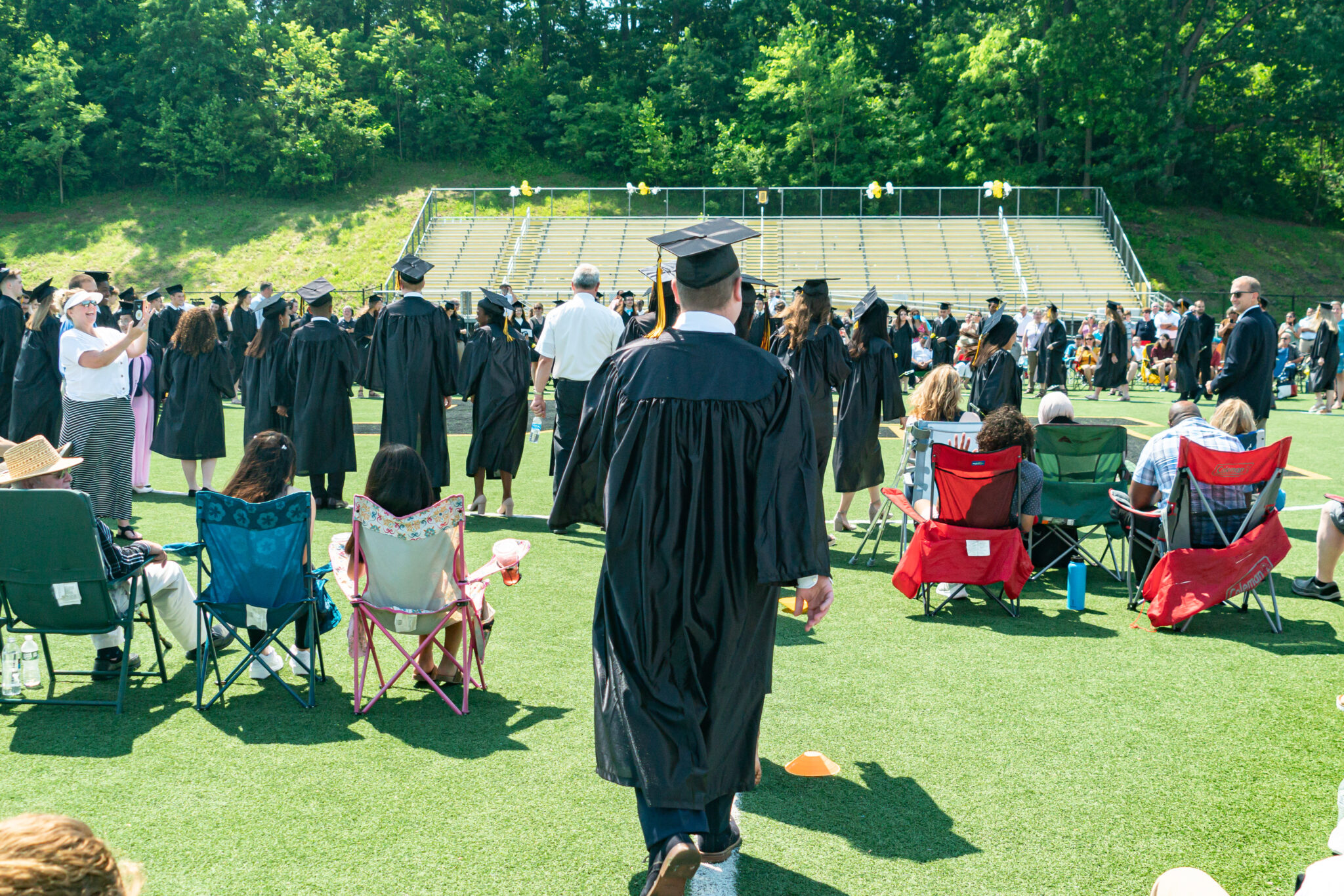 graduates and families celebrate after commencement service