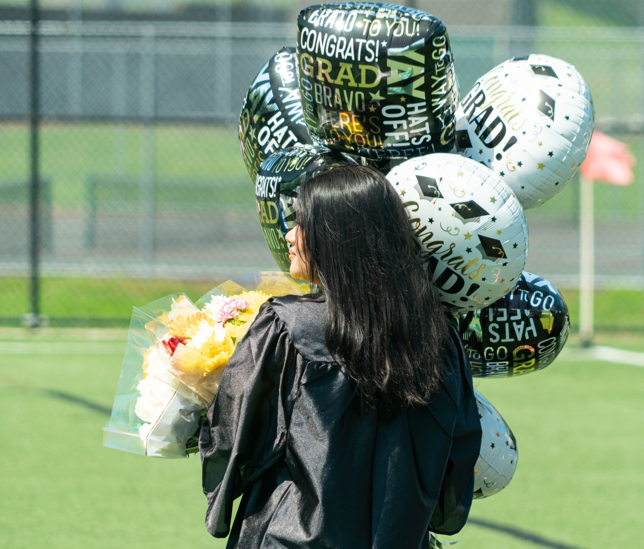graduate with balloons