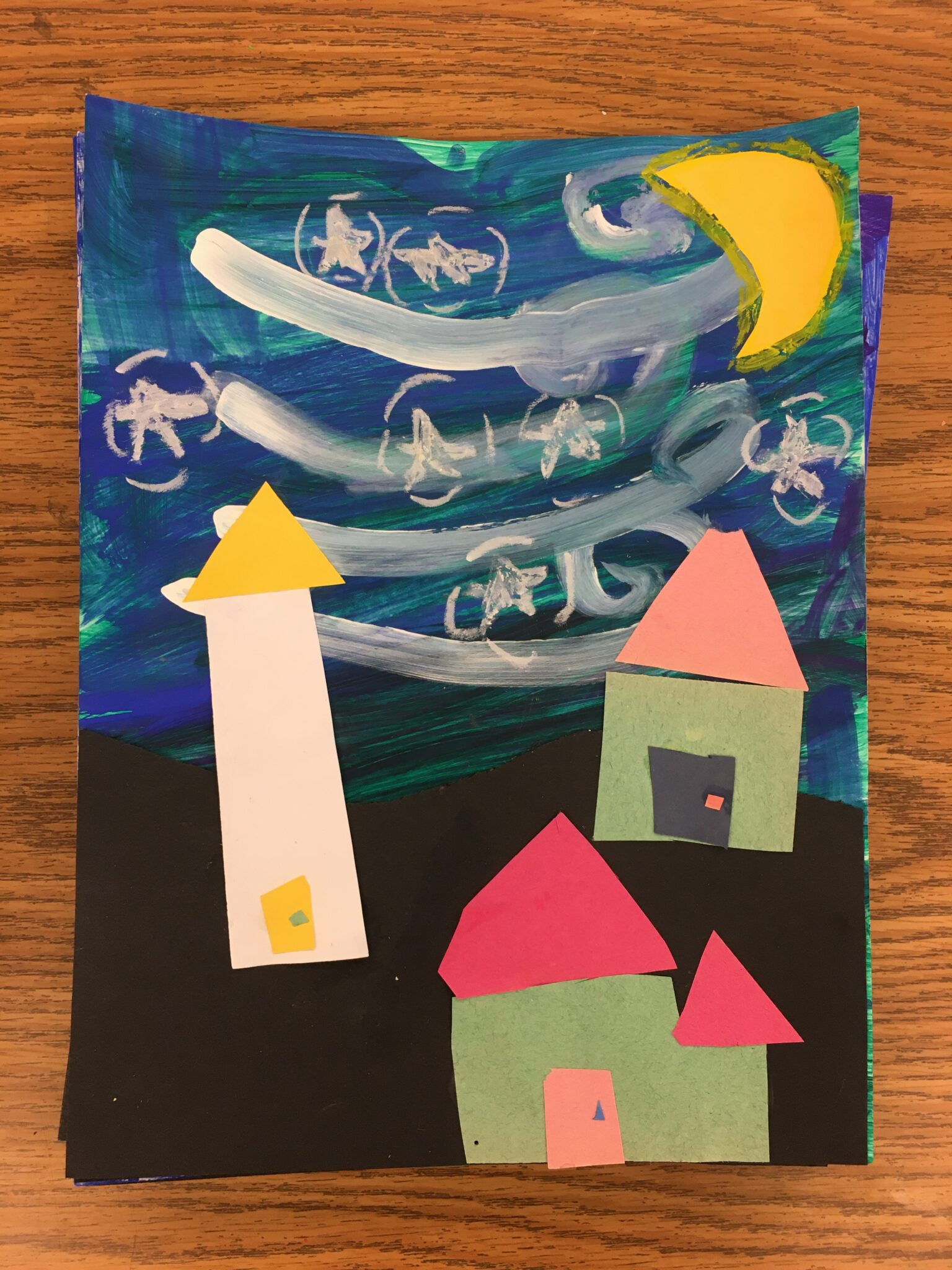 paintings and colored paper houses
