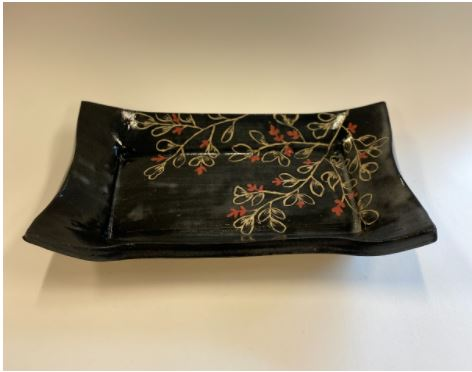 black and red ceramic platter
